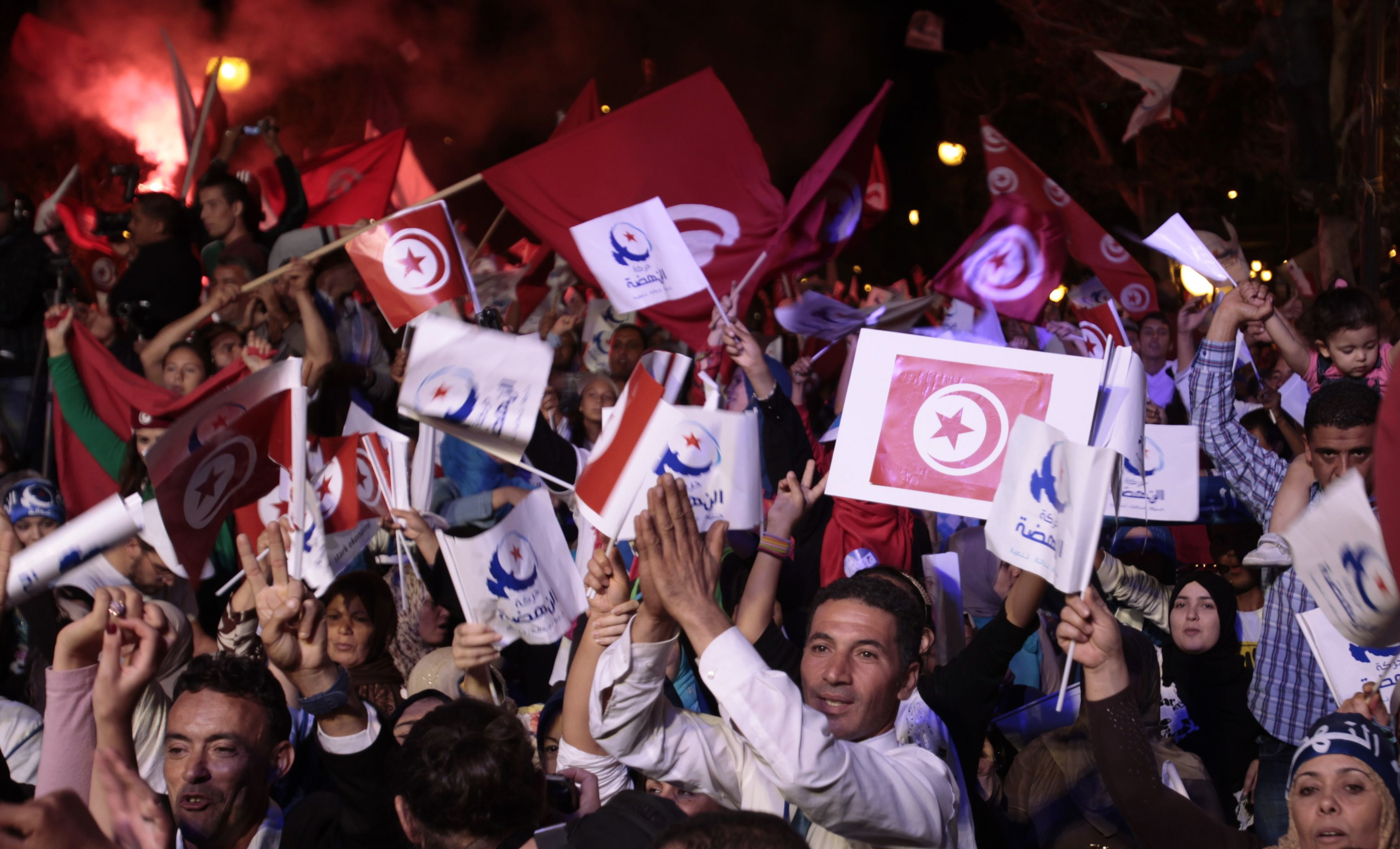 Supporters of the Islamist Ennahda movement wave party flags during a campaign event in Tunis October 24, 2014. Tunisia will hold parliamentary elections on October 26 and a presidential ballot in November. REUTERS/Zoubeir Souissi