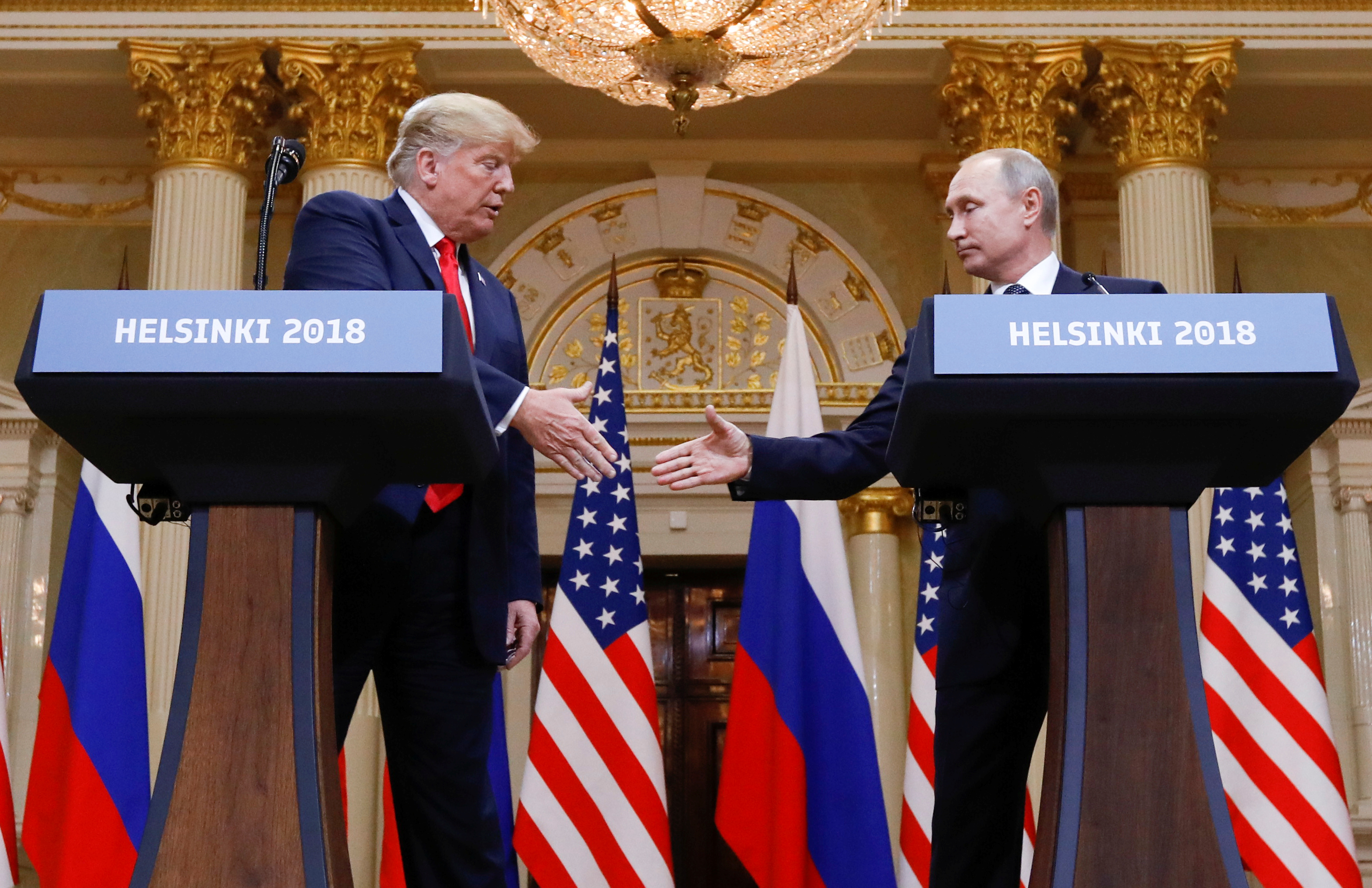 U.S. President Donald Trump and Russia's President Vladimir Putin shake hands during a joint news conference after their meeting in Helsinki, Finland, July 16, 2018. REUTERS/Kevin Lamarque - RC145902DE10