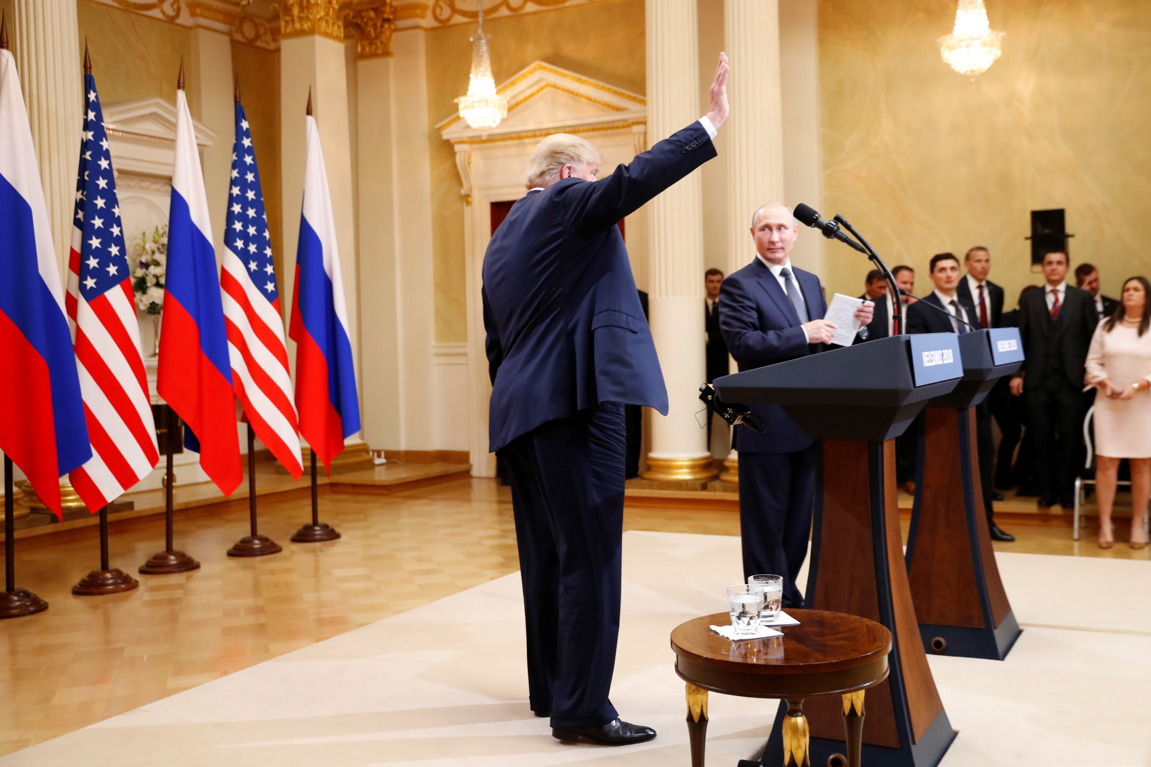 U.S. President Donald Trump waves after a joint news conference with Russia's President Vladimir Putin after their meeting in Helsinki, Finland, July 16, 2018. REUTERS/Kevin Lamarque - RC14F642E170
