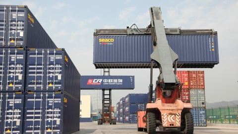 Container handlers transport containers at the railway port in Yiwu, Zhejiang province, China April 15, 2017. Picture taken April 15, 2017. To match Insight CHINA-EUROPE/SILKROAD  REUTERS/Stringer  ATTENTION EDITORS - THIS IMAGE WAS PROVIDED BY A THIRD PARTY. CHINA OUT. - RC182DBB0320