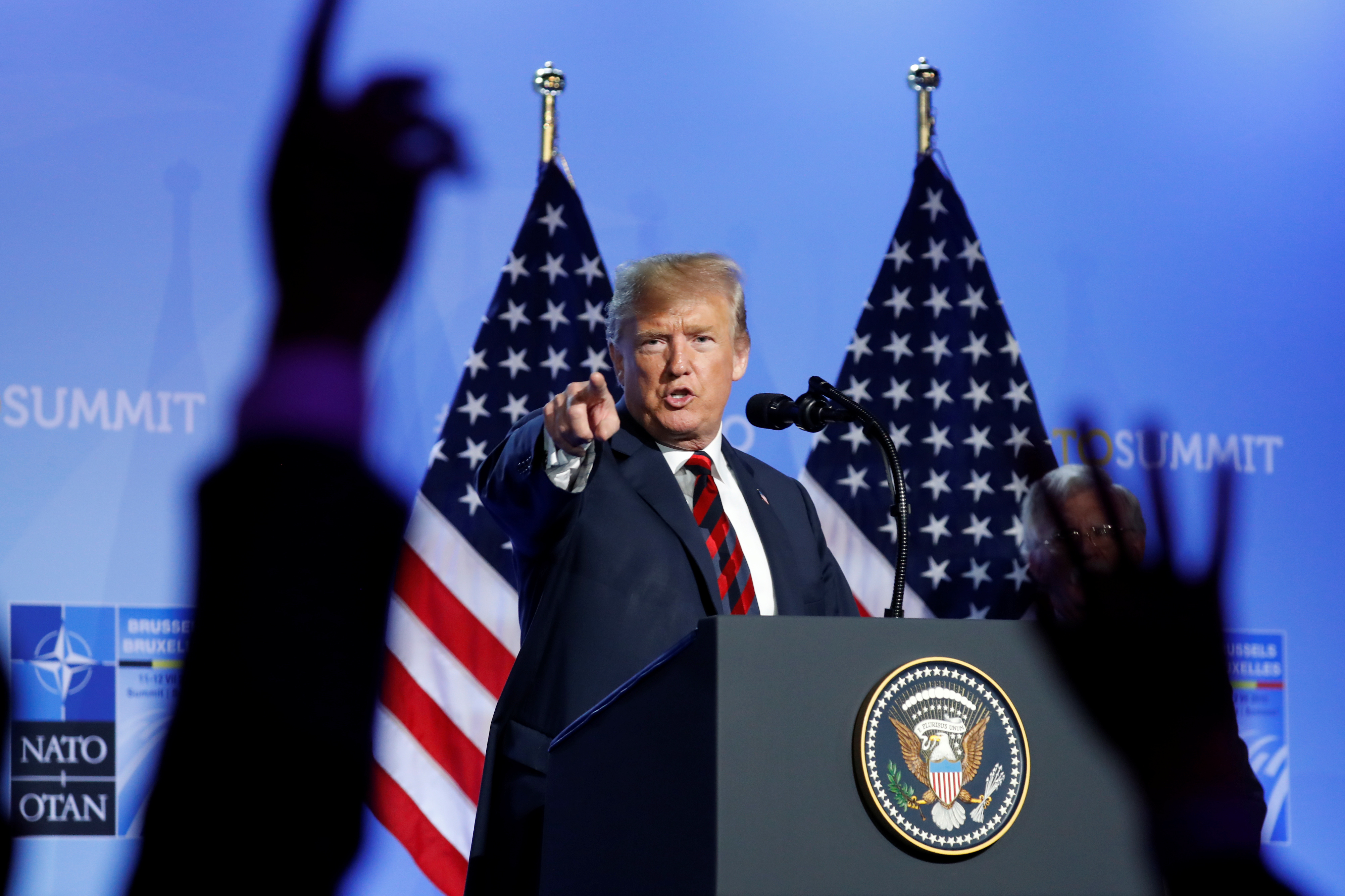 U.S. President Donald Trump takes questions from the media during a news conference after participating in the NATO Summit in Brussels, Belgium July 12, 2018. REUTERS/Kevin Lamarque - RC1988096060