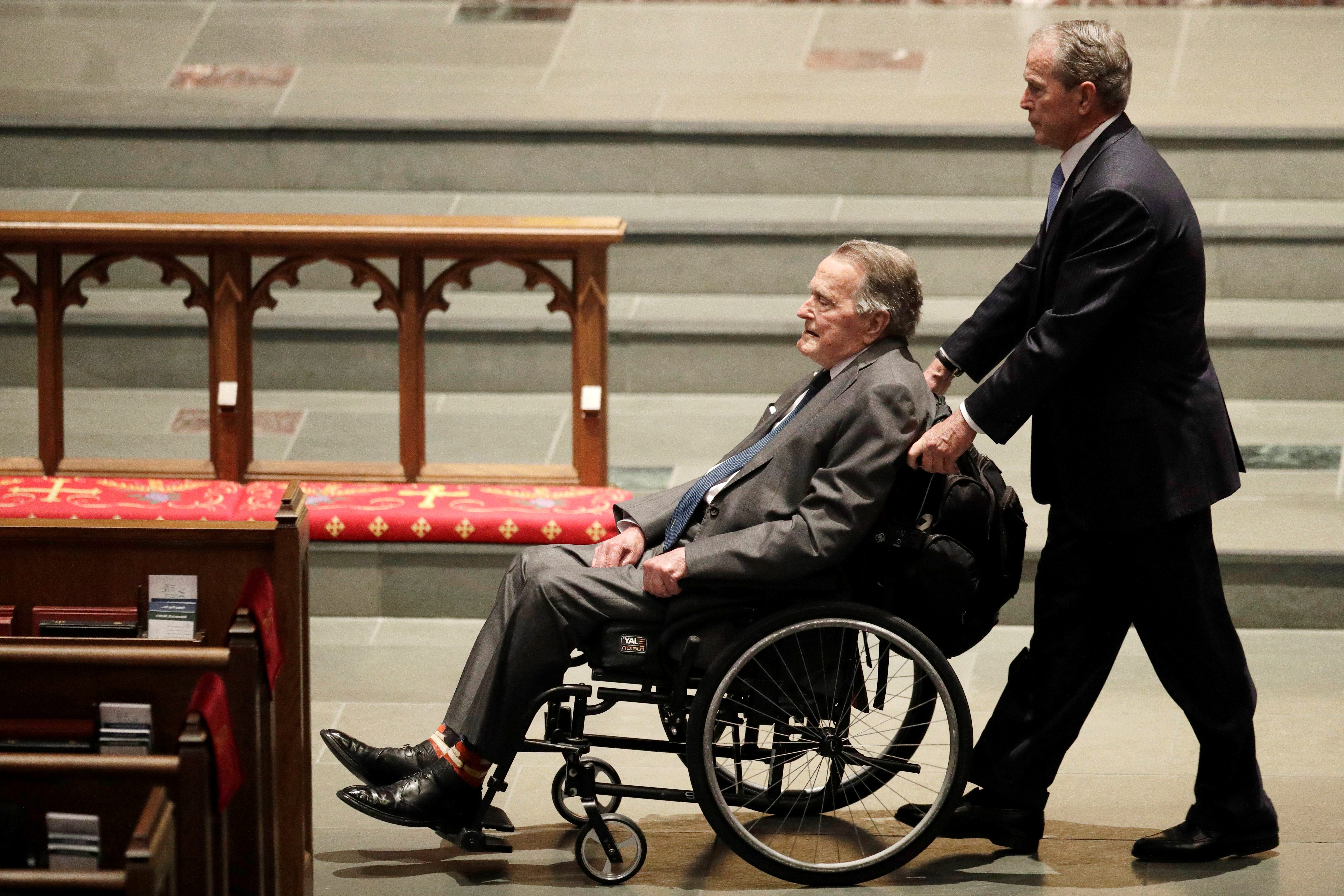 Former Presidents George W. Bush, and George H.W. Bush arrive at St. Martin's Episcopal Church for funeral services for former first lady Barbara Bush in Houston, Texas, U.S., April 21, 2018.   David J. Phillip/Pool via Reuters - RC19CCE88350