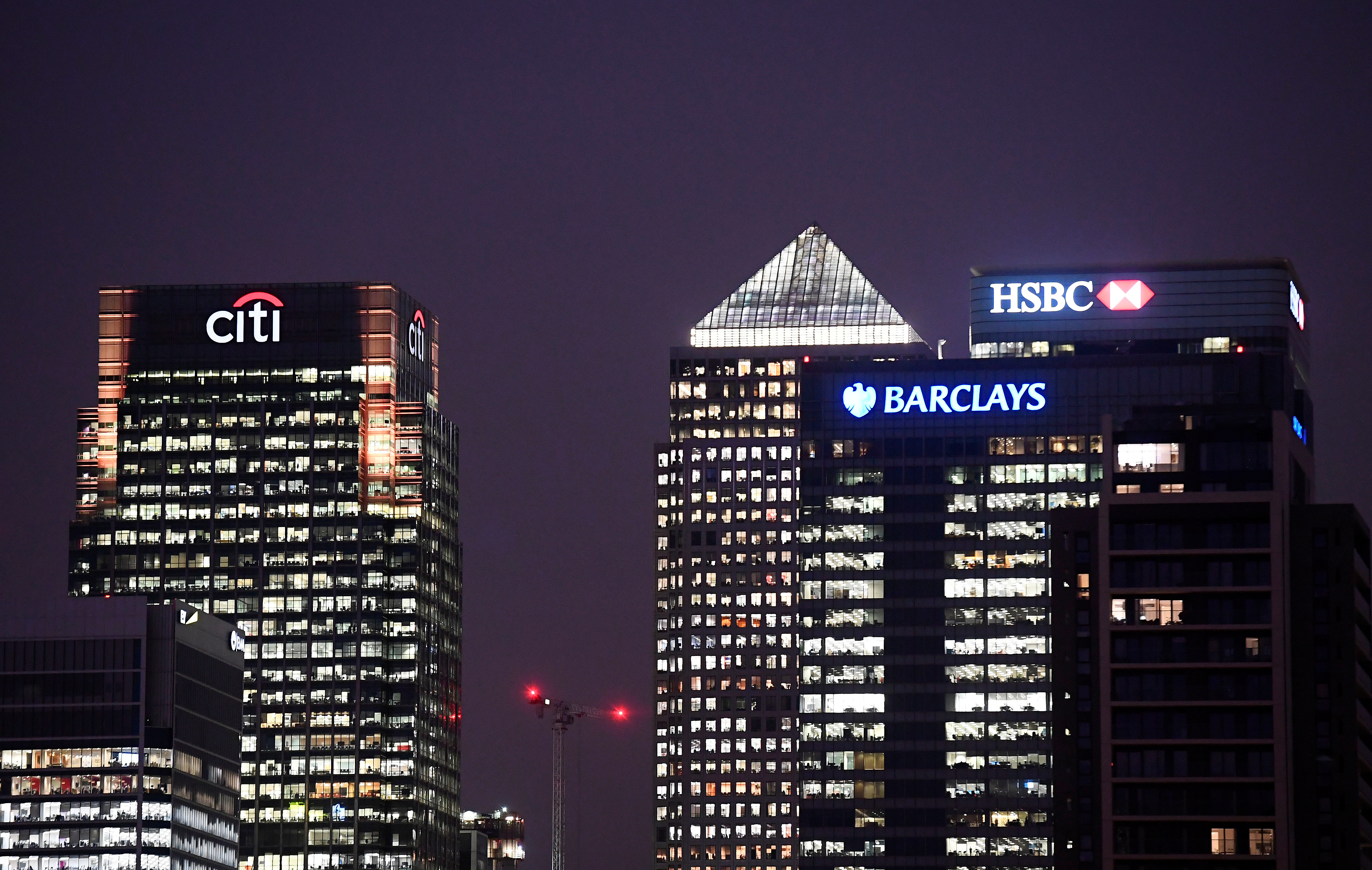 Office blocks of Citi, Barclays, and HSBC banks are seen at dusk in the Canary Wharf financial district in London, Britain November 16, 2017. REUTERS/Toby Melville - RC1813E62240