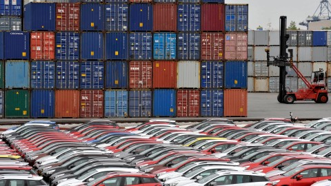 Renault cars produced in Turkey and awaiting export throughout Europe, are lined-up in front of ship containers in the port of Koper October 14, 2013. Automotive industry association ACEA said October 16, 2013, that new car registrations in Europe climbed 5.5 percent to 1.19 million vehicles in September, only the third month a gain was recorded in the past two years. But within the European Union, the level of demand was the second lowest on record for the month of September since it began tabulating results for the 27 member states in 2003. Picture taken October 14. REUTERS/Srdjan Zivulovic (SLOVENIA - Tags: TRANSPORT BUSINESS) - BM2E9AF0WYI01