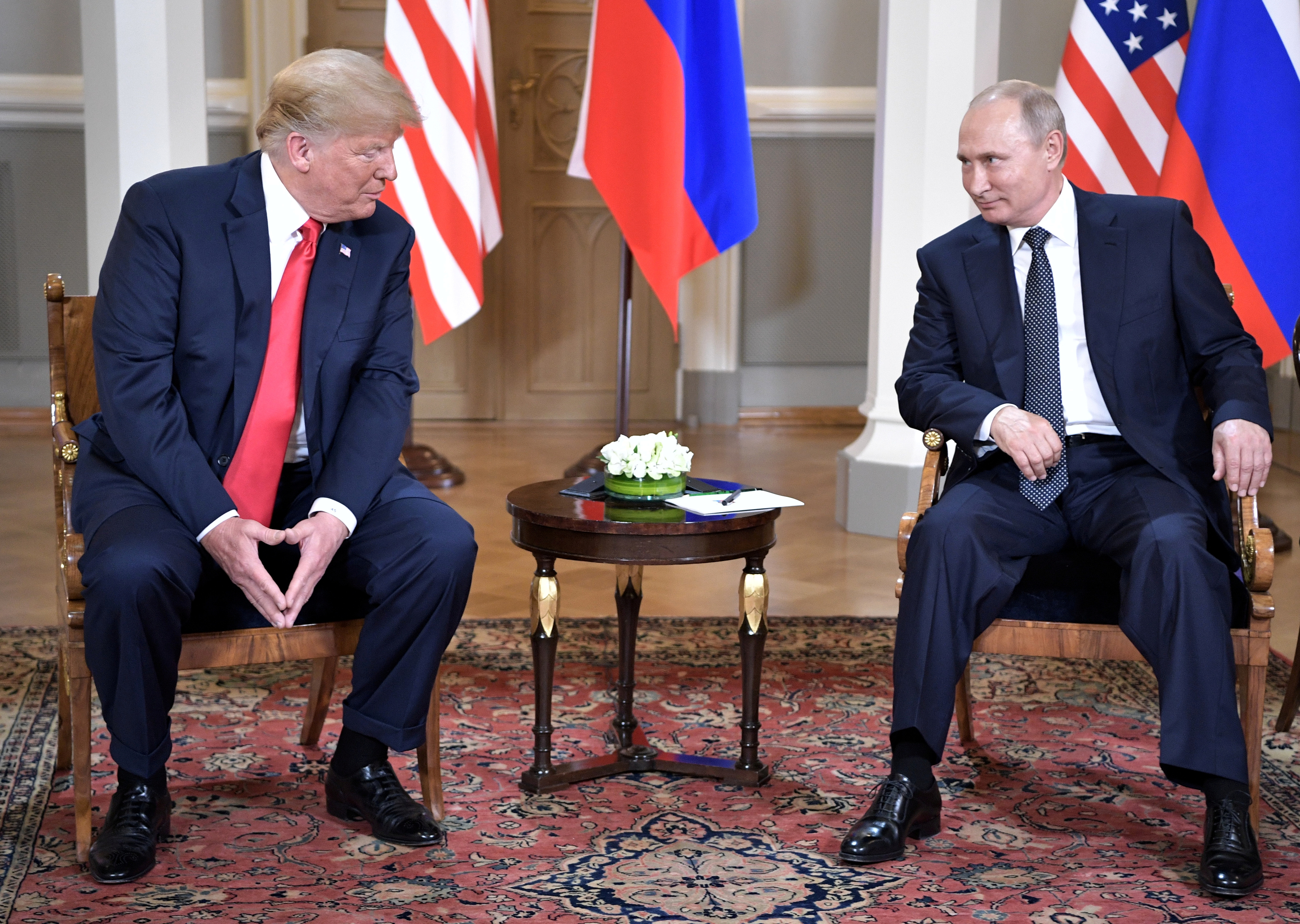 Russia's President Vladimir Putin (R) and U.S. President Donald Trump attend a meeting in Helsinki, Finland July 16, 2018. Sputnik/Alexei Nikolsky/Kremlin via REUTERS  ATTENTION EDITORS - THIS IMAGE WAS PROVIDED BY A THIRD PARTY. - RC1AA427BD00