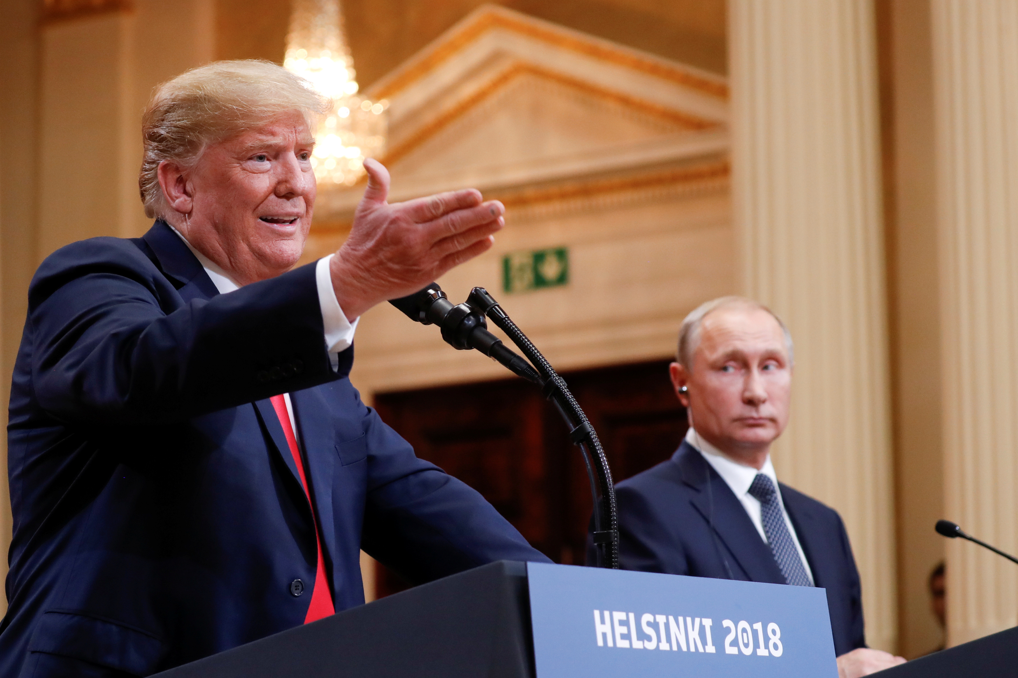 U.S. President Donald Trump gestures during a joint news conference with Russia's President Vladimir Putin after their meeting in Helsinki, Finland, July 16, 2018. REUTERS/Kevin Lamarque - RC11FBFEF700