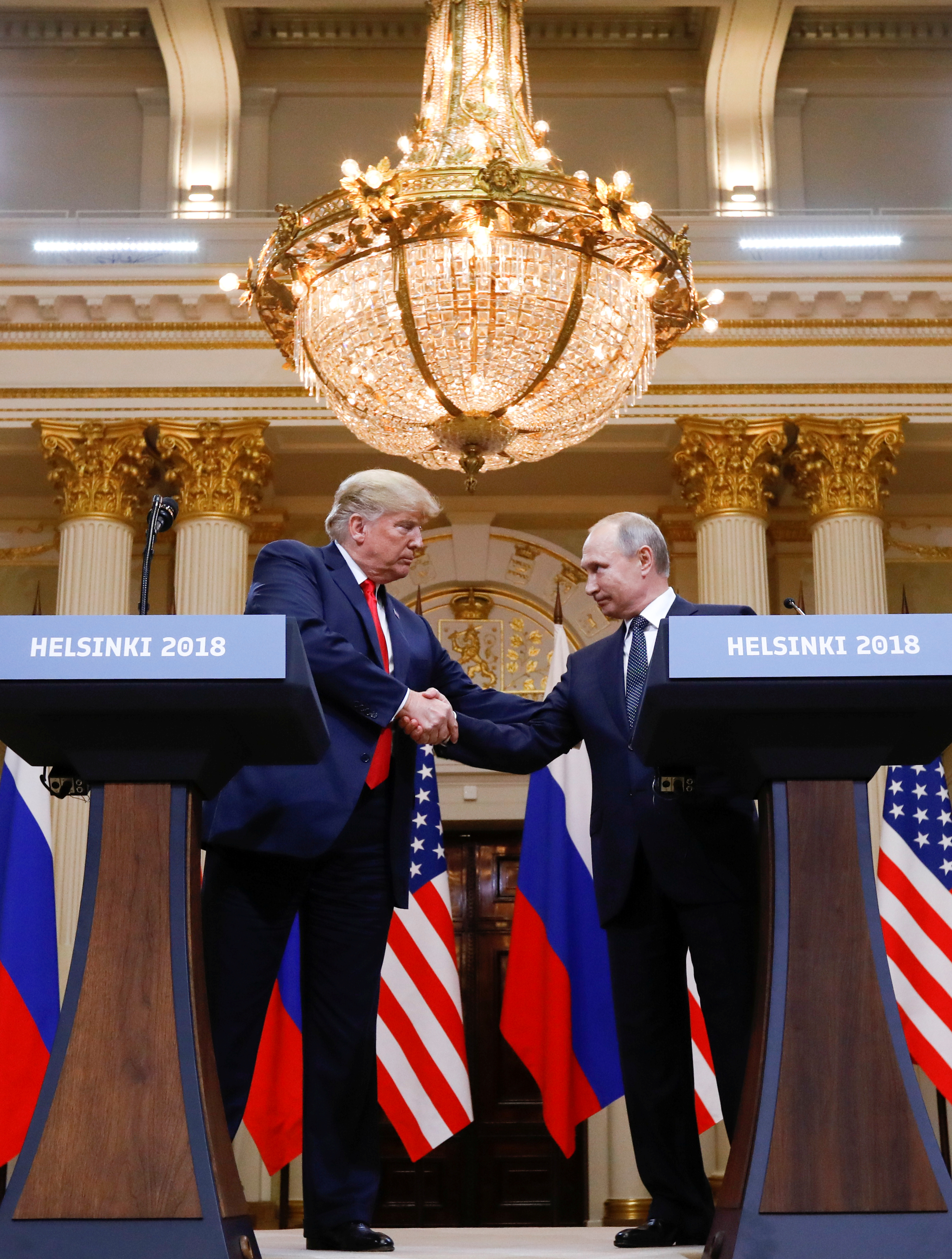 U.S. President Donald Trump and Russia's President Vladimir Putin shake hands during a joint news conference after their meeting in Helsinki, Finland, July 16, 2018. REUTERS/Kevin Lamarque - RC181F828BC0