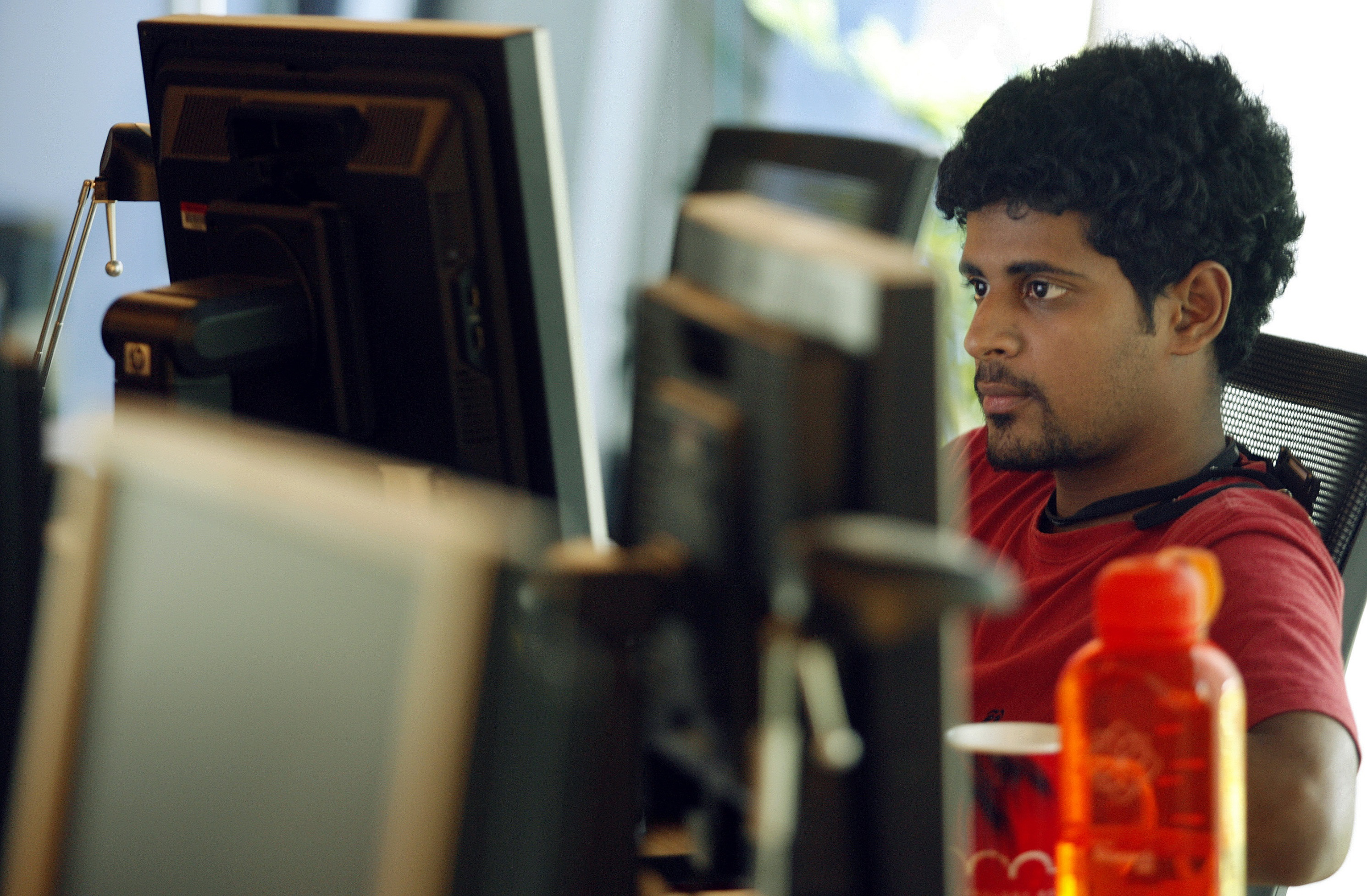 A researcher works on his terminal at the Microsoft India research centre in Bangalore June 24, 2009. Staffed with about 60 full-time researchers, many of them Indians with PhDs from top universities in the United States, the centre is at the cutting edge of Microsoft's R&D. It covers seven areas of research including mobility and cryptography. Its success, including developing a popular tool for Microsoft's new search engine Bing, underscores the potential of R&D in India at a time when cost-conscious firms are keen to offshore to save money by using talented researchers abroad.  To match feature INDIA-R&D/ REUTERS/Punit Paranjpe (INDIA SCI TECH BUSINESS) - GM1E57L0LK701