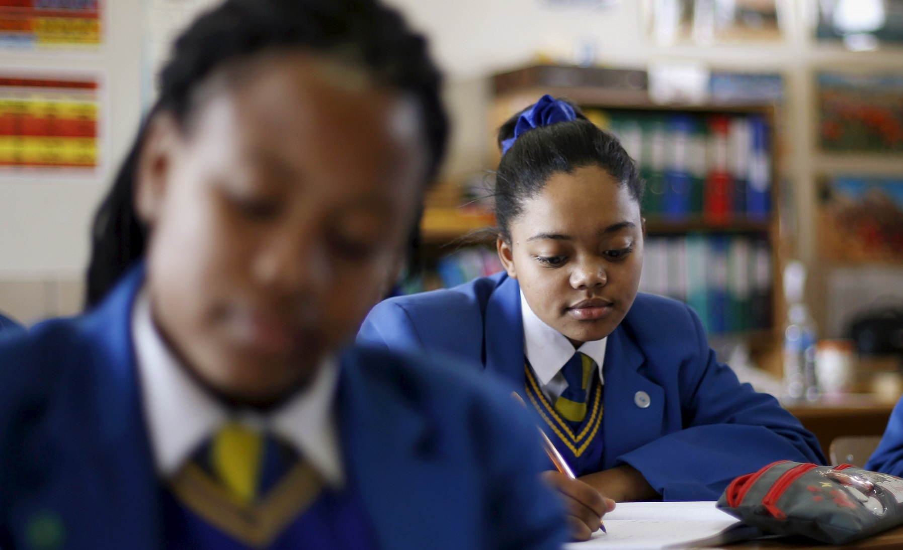 """School children attend class at Waterstone College, a private school managed by Curro in the south of Johannesburg July 22, 2015. South African private education group Advtech rejected a takeover offer from its bigger rival Curro Holdings, saying on Tuesday the proposal contained """"unacceptable pre-conditions"""". Advtech's shares fell more than 7 percent shortly after the announcement that it had rejected Curro's bid, but pared losses to close down 2.93 percent at 11.60 rand. The shares are up about 30 percent so far this year. Curro's stock shed 0.83 percent to close on 11.70 rand. REUTERS/Siphiwe Sibeko  - GF10000166735"""