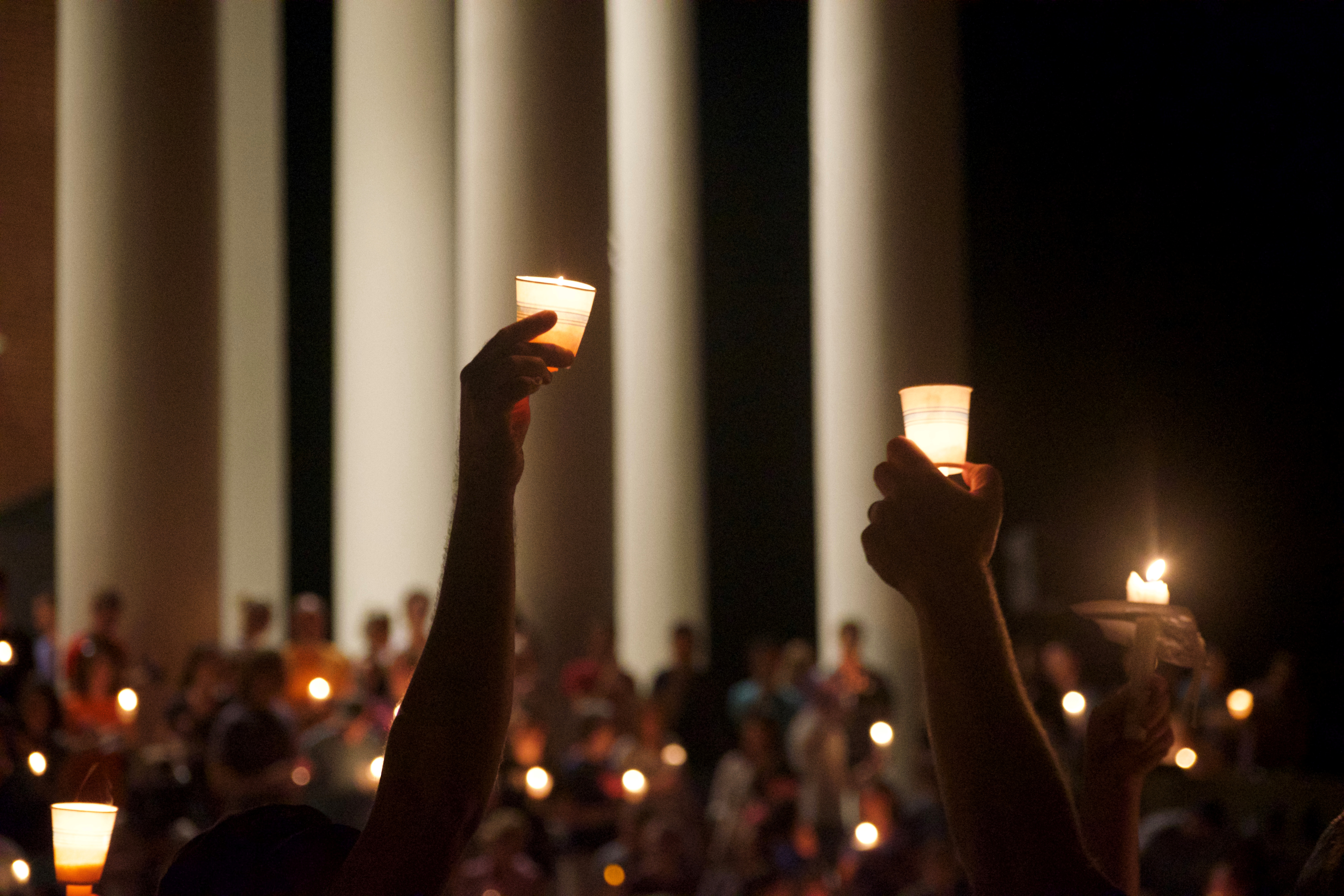 Members of the Charlottesville community hold a vigil for Heather Heyer at the University of Virginia in Charlottesville.