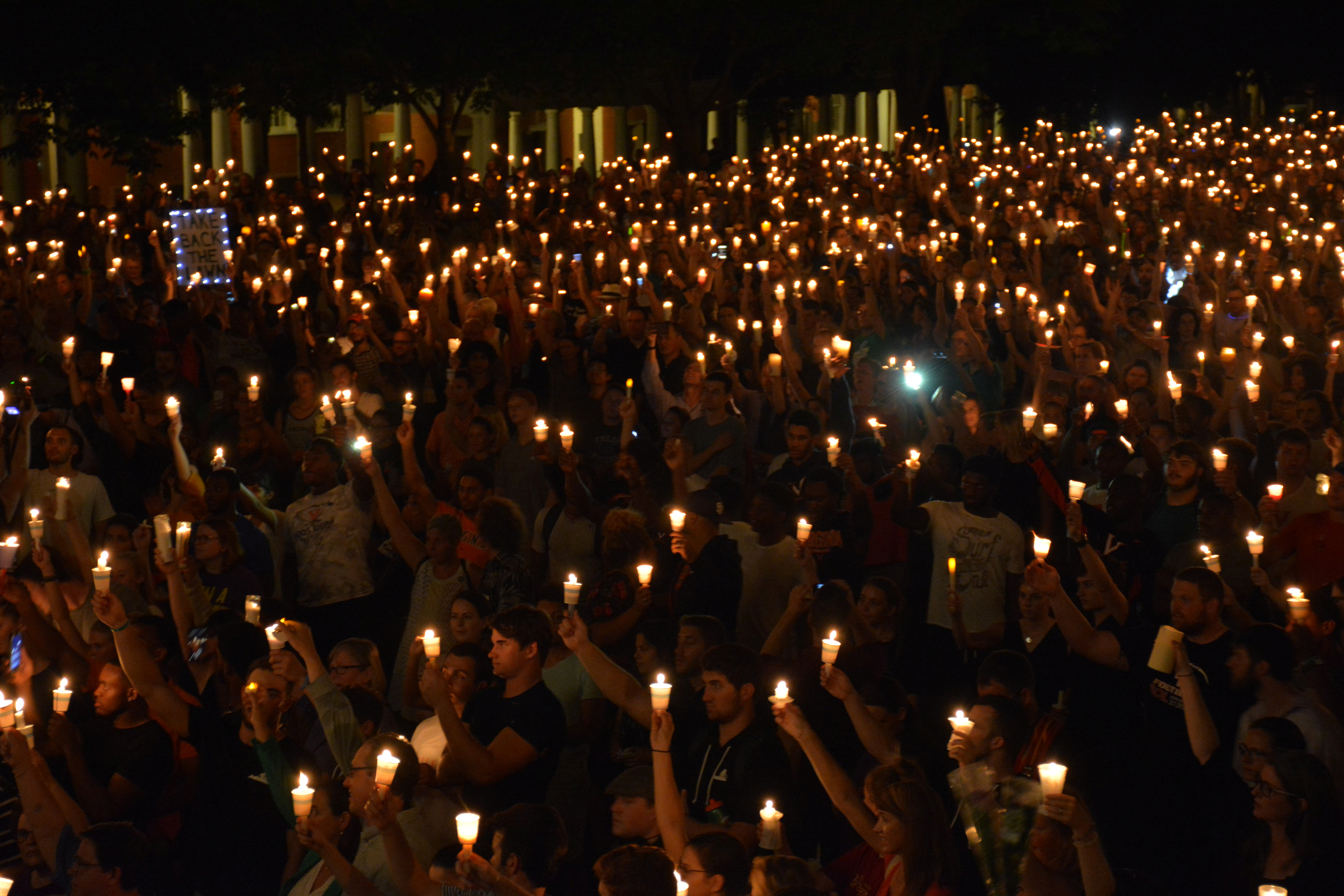 Members of the Charlottesville community hold a vigil for Heather Heyer following last Saturday's protest organized by white nationalists that turned deadly at the University of Virginia in Charlottesville, Virginia, U.S. on August 16, 2017. Picture taken on August 16, 2017.   Courtesy Tim Dodson/The Cavalier Daily/Handout via REUTERS   ATTENTION EDITORS - THIS IMAGE WAS PROVIDED BY A THIRD PARTY. MANDATORY CREDIT. - RC1AE091ECB0