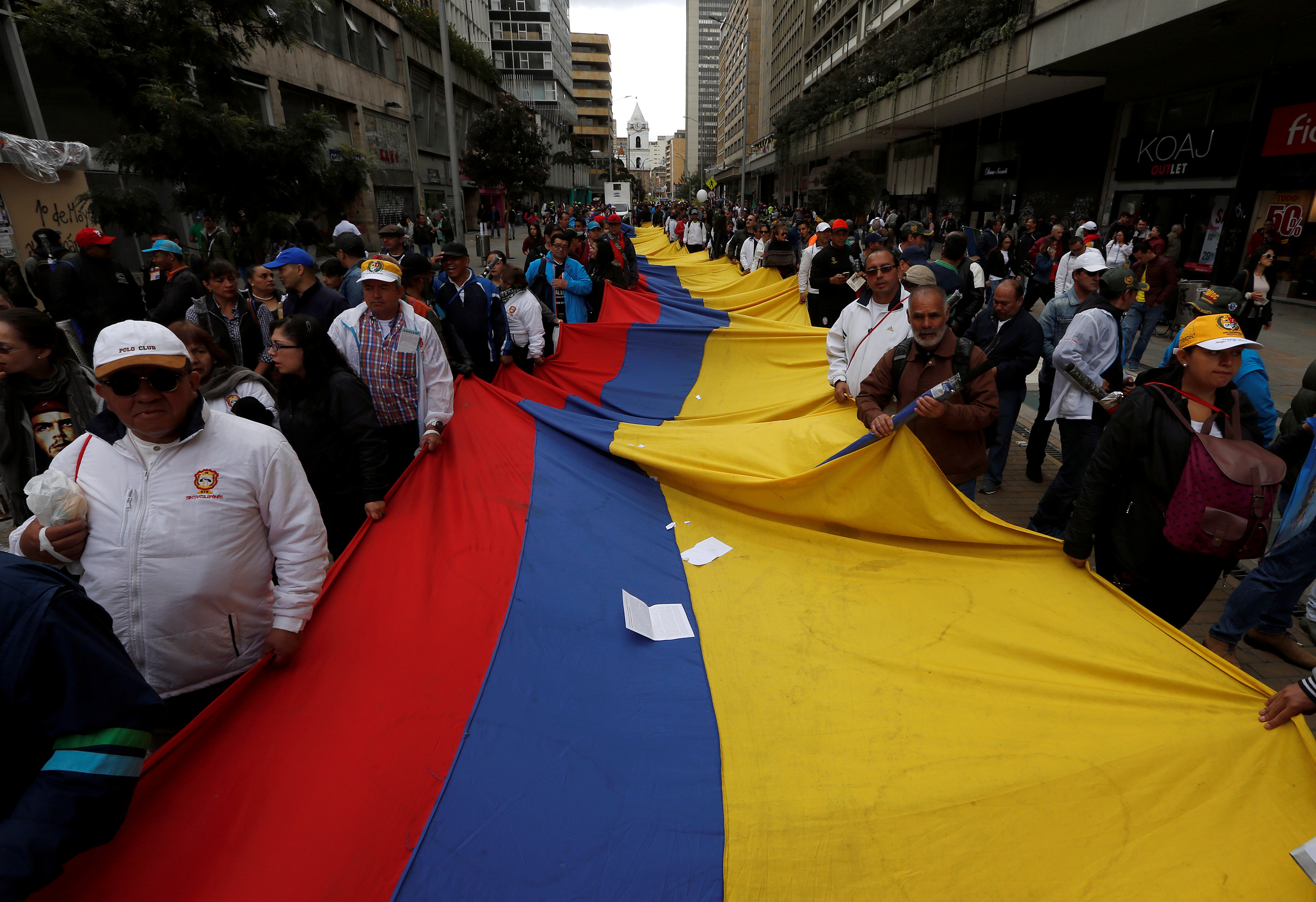 Demonstrators hold a flag during a rally commemorating May Day in Bogota, Colombia May 1, 2018. REUTERS/Jaime Saldarriaga - RC163BBBBF30