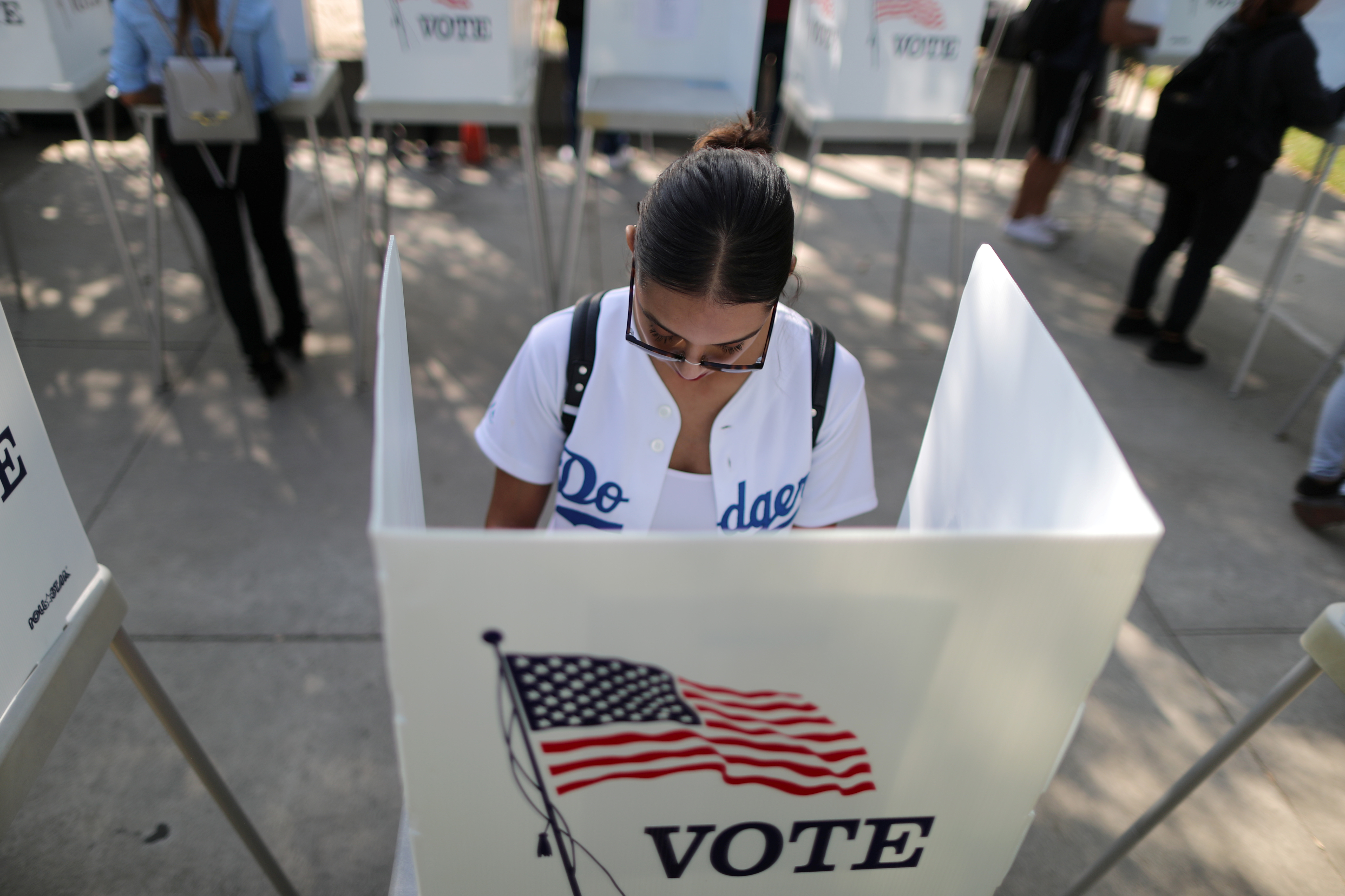 Cynthia Lazo, 25, votes in the U.S. congressional and gubernatorial midterm elections in Norwalk