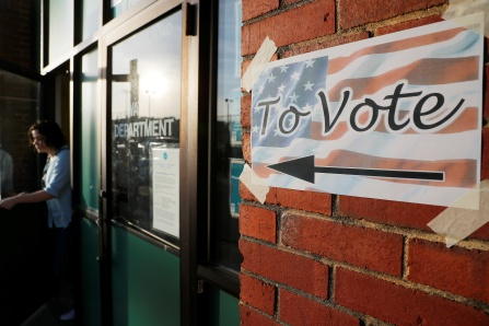 A voter leaves a polling site after casting a ballot in the Massachusetts Primary Election in Somerville, Massachusetts, U.S., September 4, 2018.   REUTERS/Brian Snyder - RC1CBC656A50