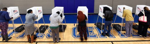 Citizens vote on a basketball court at a recreation center serving as polling place during the U.S. general election in Greenville, North Carolina, U.S. November 8, 2016.  REUTERS/Jonathan Drake - HT1ECB81QZBBW