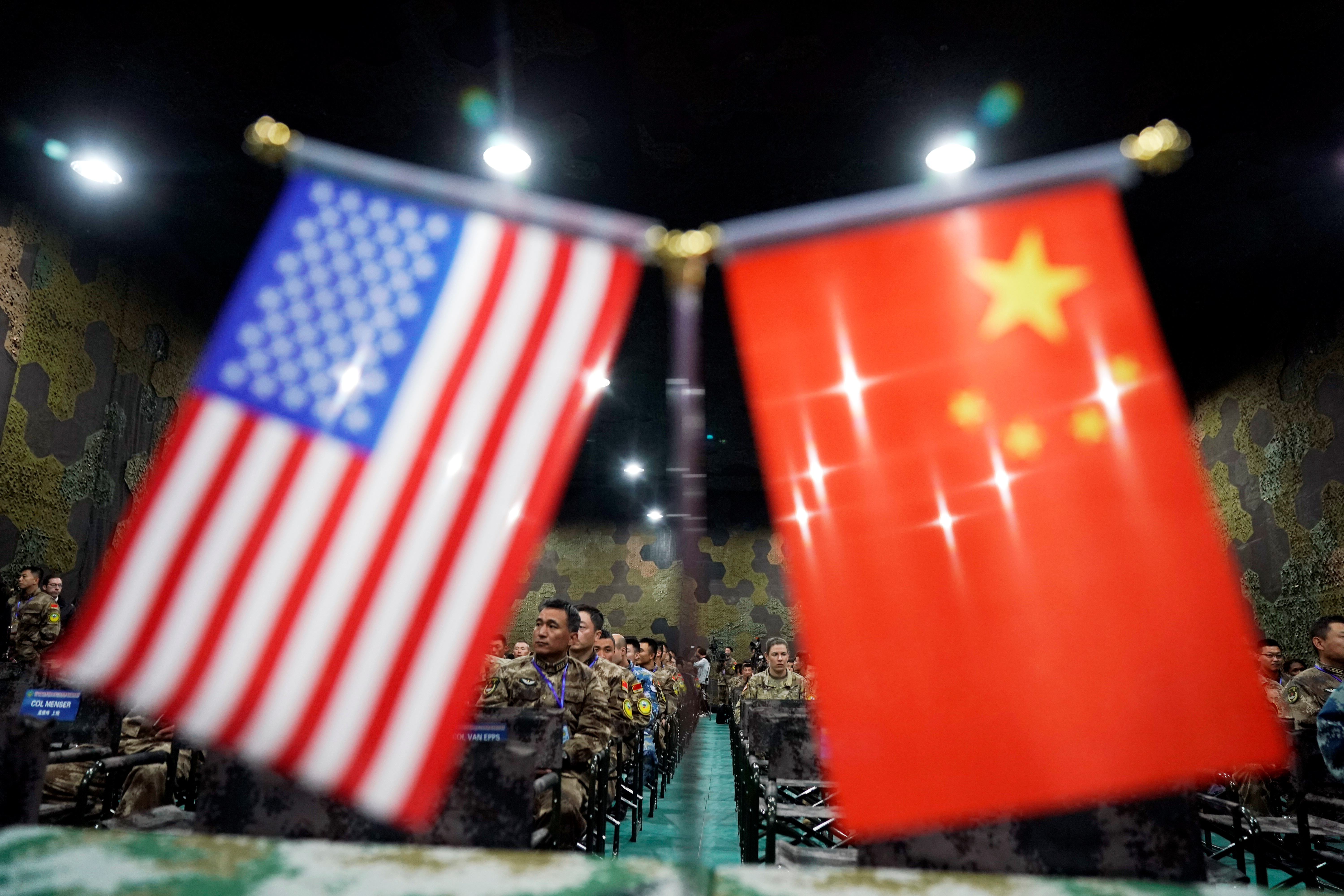 """U.S. Army and China's People's Liberation Army (PLA) military personnel attend a closing ceremony of an exercise of """"Disaster Management Exchange"""" near Nanjing, Jiangsu province, China."""