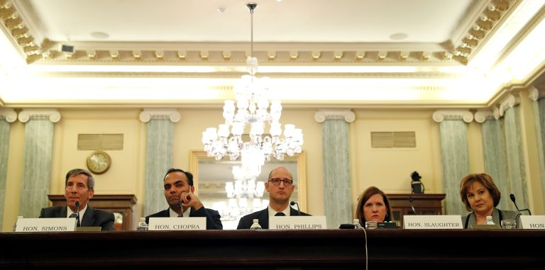 """Federal Trade Chairman Joseph Simons, (L), Federal Trade Commissioners (2nd L-R), Rohit Chopra, Noah Phillips, Rebecca Slaughter and Christine Wilson testify on the """"Oversight of the Federal Trade Commission"""" before the U.S. Senate Consumer Protection, Product Safety, Insurance and Data Security Subcommittee in the Russell Senate Office Building in Washington, U.S., November 27, 2018. REUTERS/ Leah Millis - RC1654D52A80"""