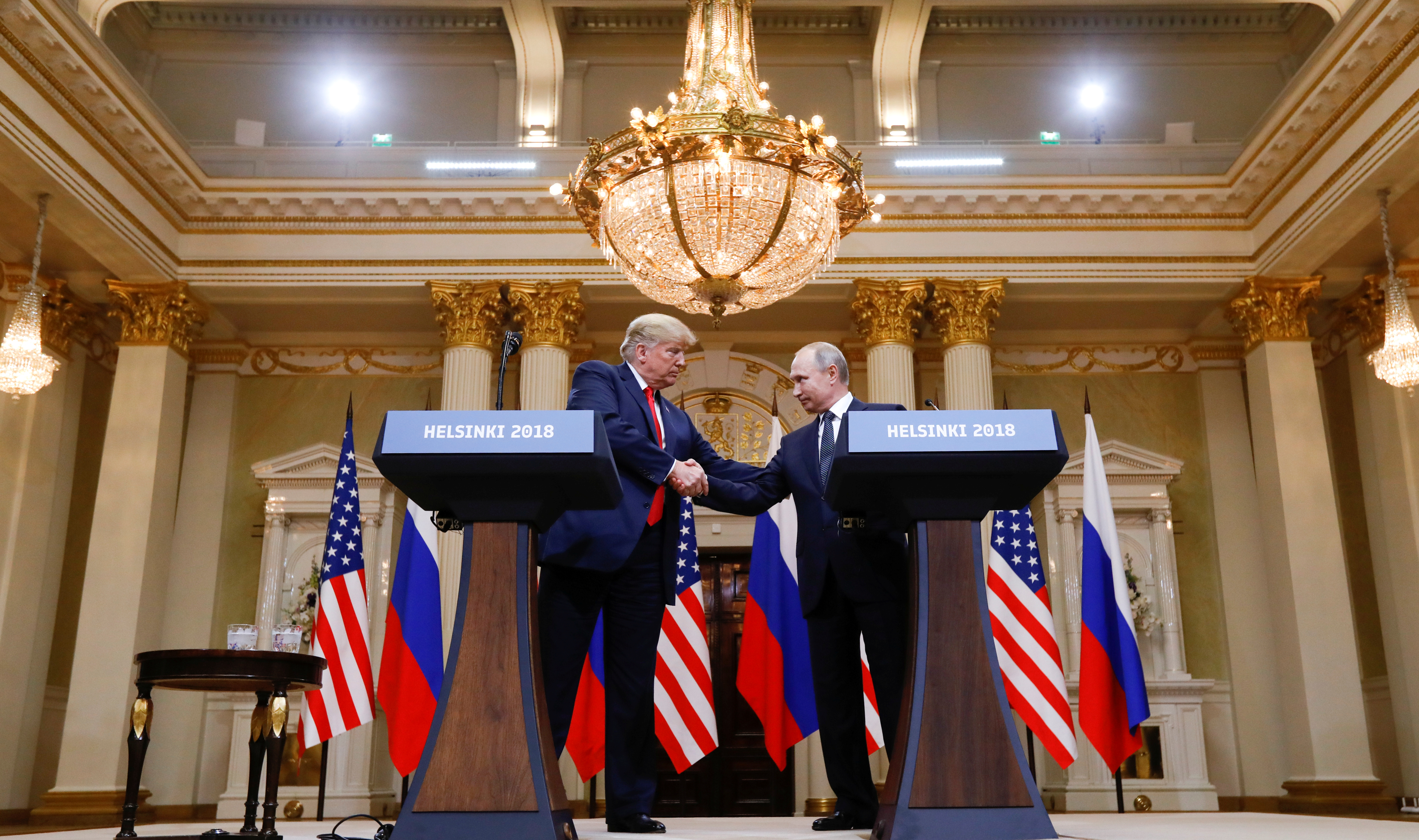 U.S. President Donald Trump and Russia's President Vladimir Putin shake hands during a joint news conference after their meeting in Helsinki, Finland, July 16, 2018. REUTERS/Kevin Lamarque - RC165B49D900
