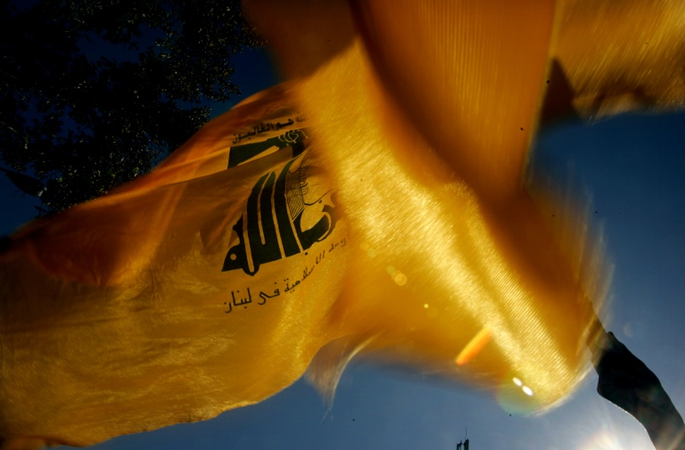 """An Iranian protester (unseen) waves the Lebanon's Hezbollah's flag during a rally in front of the former U.S. embassy in Tehran to mark the anniversary of Student's Day November 4, 2006. Thousands of Iranians on Saturday chanted """"Death to America"""" outside the former U.S. embassy which students stormed on this day in 1979, renewing Iran's defiance at a time when it faces possible sanctions for its nuclear work. REUTERS/Morteza Nikoubazl(IRAN) - GM1DTWFPDLAA"""