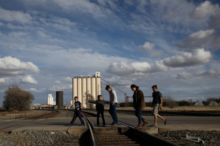 """The children of Orfa, a migrant from Honduras, Rachel (second L), Carolina (second R) and Bayron (R), walk to a park to play with neighbours Jose (L) and Jefferson (C) in Texico, New Mexico, U.S., November 30, 2018. REUTERS/Loren Elliott  SEARCH """"ELLIOTT ORFA"""" FOR THIS STORY. SEARCH """"WIDER IMAGE"""" FOR ALL STORIES. - RC1CBD42DD70"""