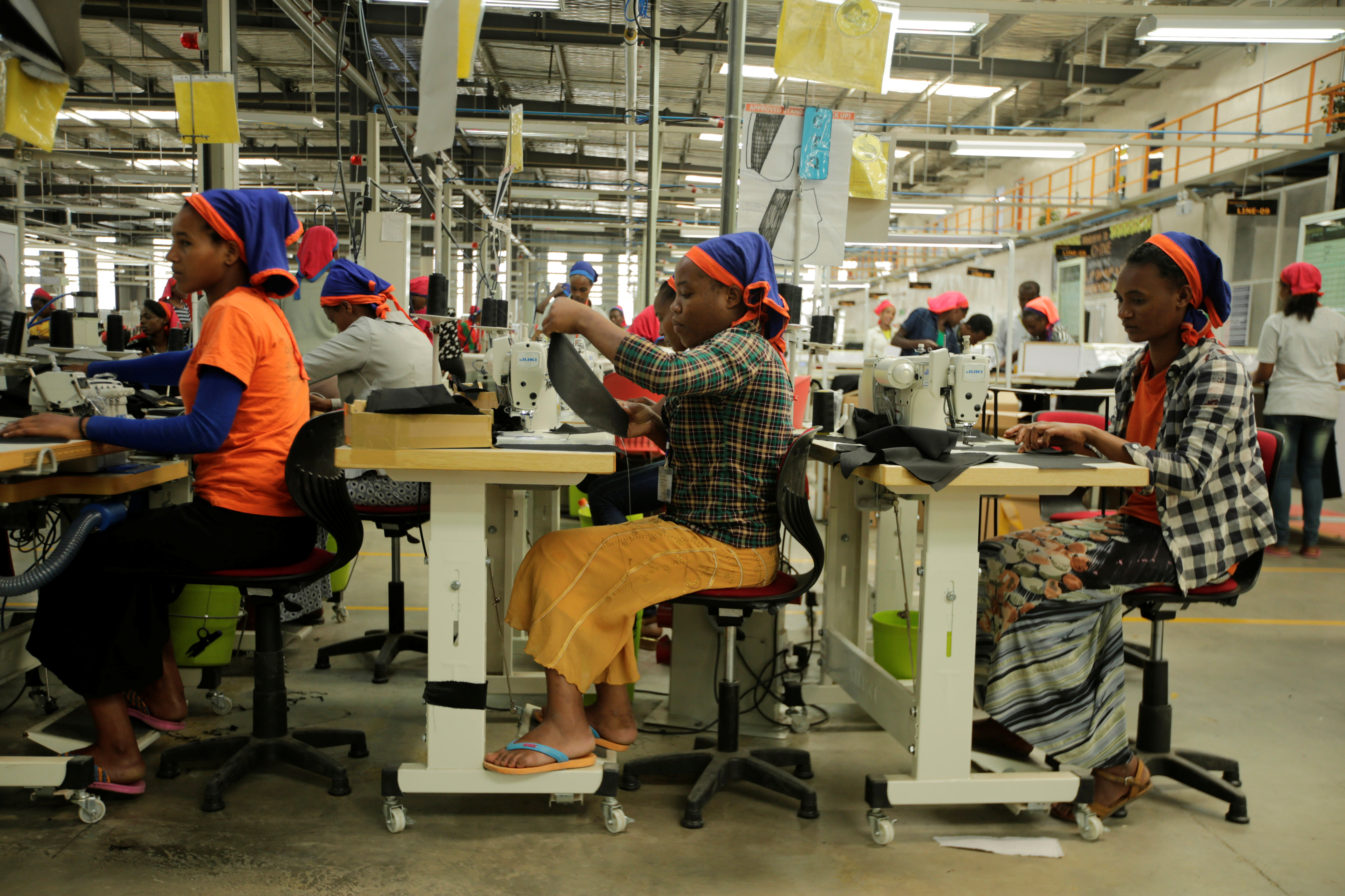 Workers sew clothes inside the Indochine Apparel PLC textile factory in Hawassa Industrial Park in Southern Nations, Nationalities and Peoples region, Ethiopia November 17, 2017. Picture taken November 17, 2017.REUTERS/Tiksa Negeri - RC1A972030A0