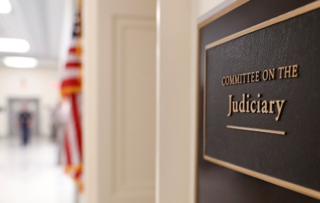 The sign for the House Judiciary Committee hearing room is visible at the Rayburn House office building where FBI lawyer Lisa Page failed to show up for a subpoena for a closed House Judiciary Committee deposition related to the ongoing congressional investigation into the Justice Department and FBI's decisions during the 2016 election in Washington, U.S., July 11, 2018. REUTERS/Leah Millis - RC11B1F228F0