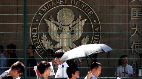 People wait outside the U.S. embassy, near the site of a blast in Beijing, China July 26, 2018. REUTERS/Damir Sagolj - RC19516BE290
