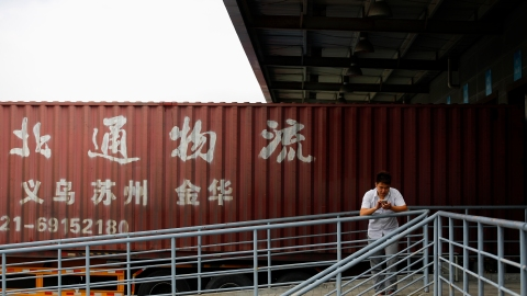 A truck driver waits at a logistics area of the Shanghai Free Trade Zone, in Shanghai September 24, 2014. A disappointing first year for Shanghai's much-hyped free-trade zone, seen as a pet project of Premier Li Keqiang and billed as a reform laboratory, raises questions about China's commitment to opening up its markets as it wrestles with a slowing economy. The 29 square kilometre zone on the outskirts of China's commercial capital - hailed as Beijing's boldest reform in decades - was meant to test changes such as currency liberalisation, market-determined interest rates and free trade. But progress has been slow and policies vague as the political focus has turned from reform to shoring up growth, leaving foreign companies unsure of investing in the free-trade zone (FTZ). REUTERS/Carlos Barria (CHINA - Tags: BUSINESS) - GM1EA9O1EJ401