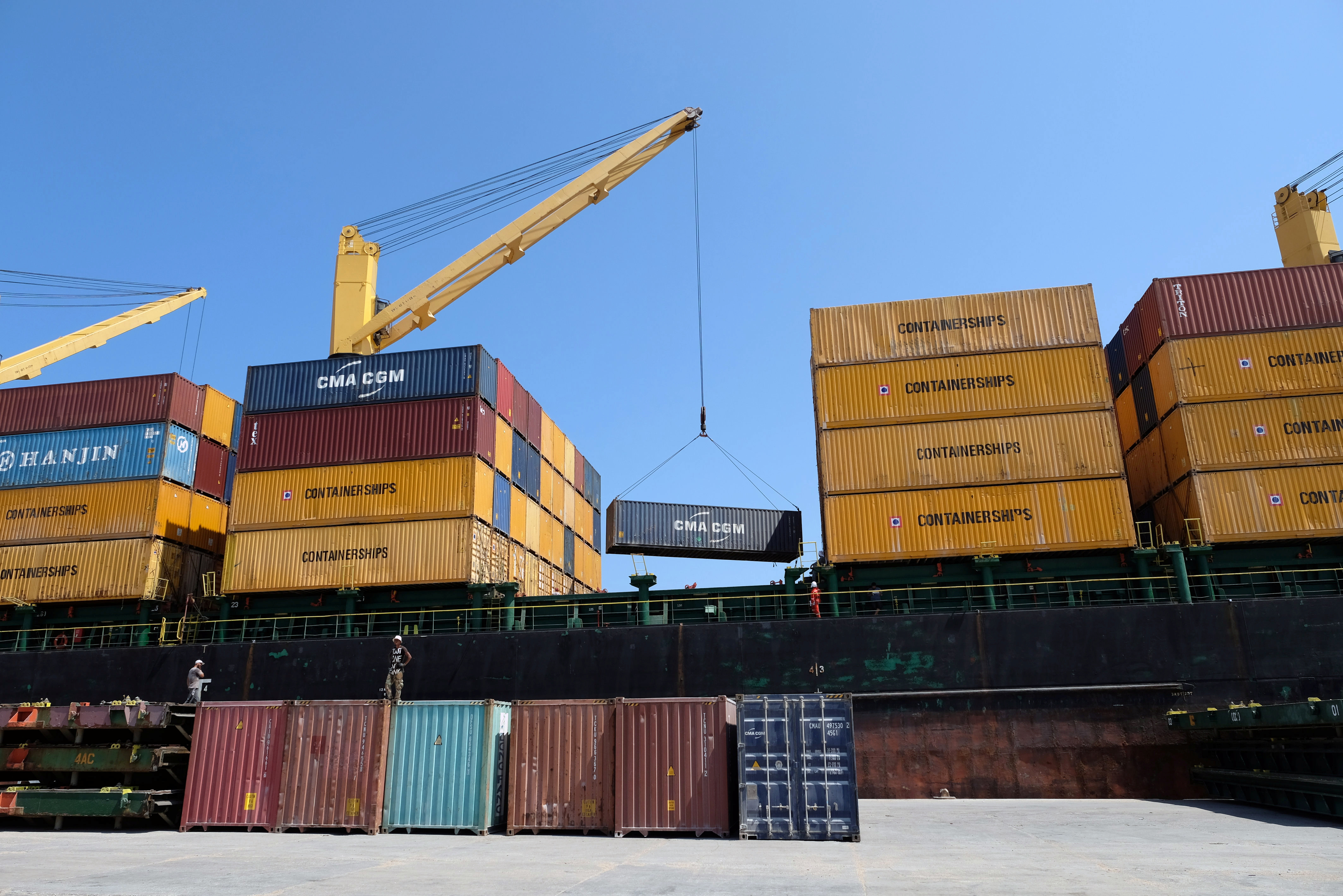 A ship transports empty containers at the seaport of Benghazi, Libya August 28, 2019. Picture taken August 28, 2019.  REUTERS/Esam Omran Al-Fetori - RC1399D965E0