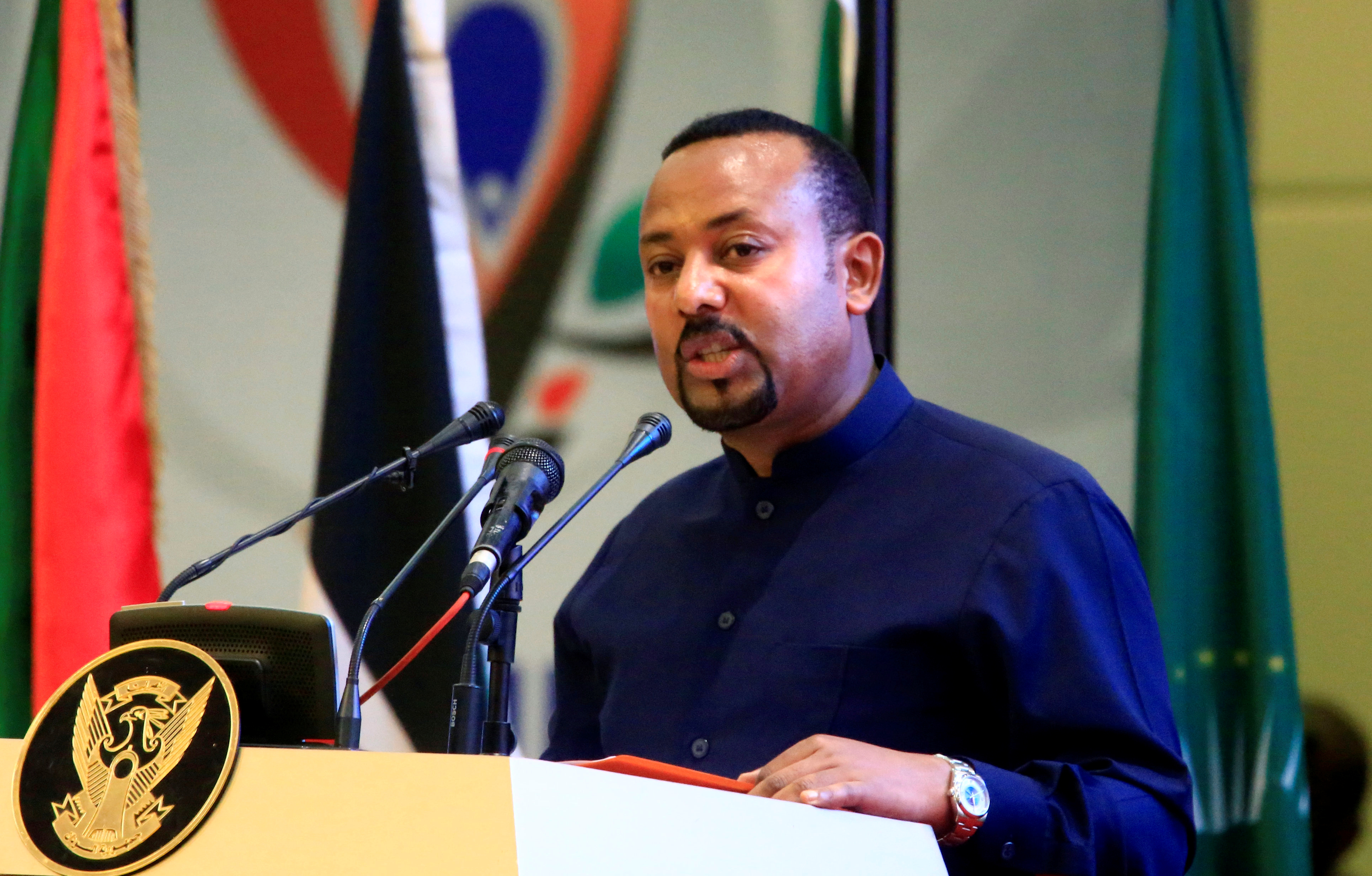 Ethiopia's Prime Minister Abiy Ahmed addresses delegates during the signing of the Sudan's power sharing deal, that paves the way for a transitional government, and eventual elections, following the overthrow of a long-time leader Omar al-Bashir, in Khartoum, Sudan, August 17, 2019. REUTERS/Mohamed Nureldin Abdallah - RC138A0BD790