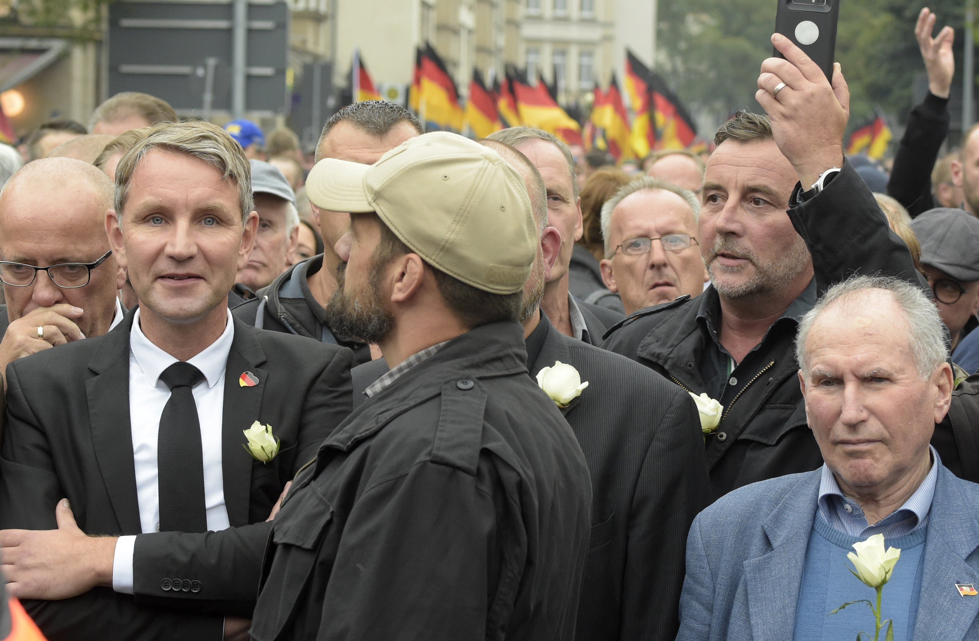 Alternative for Germany regional leader Björn Höcke (left) and PEGIDA founder Lutz Bachmann (second from right) participate in a far-right march in Chemnitz. (Jens Meyer/AP Photo)