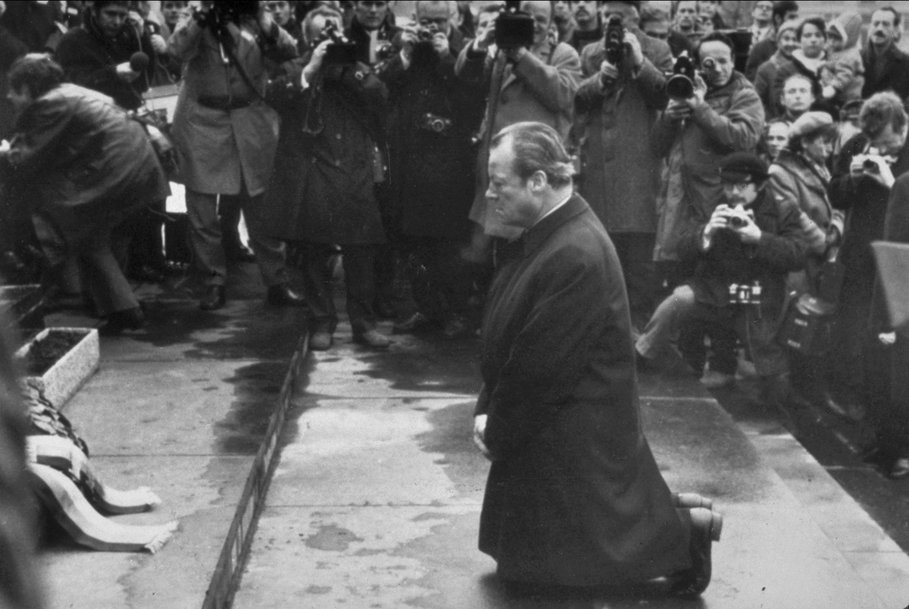 West German Chancellor Willy Brandt kneels in the Warsaw Ghetto, December 7, 1970. (Associated Press)