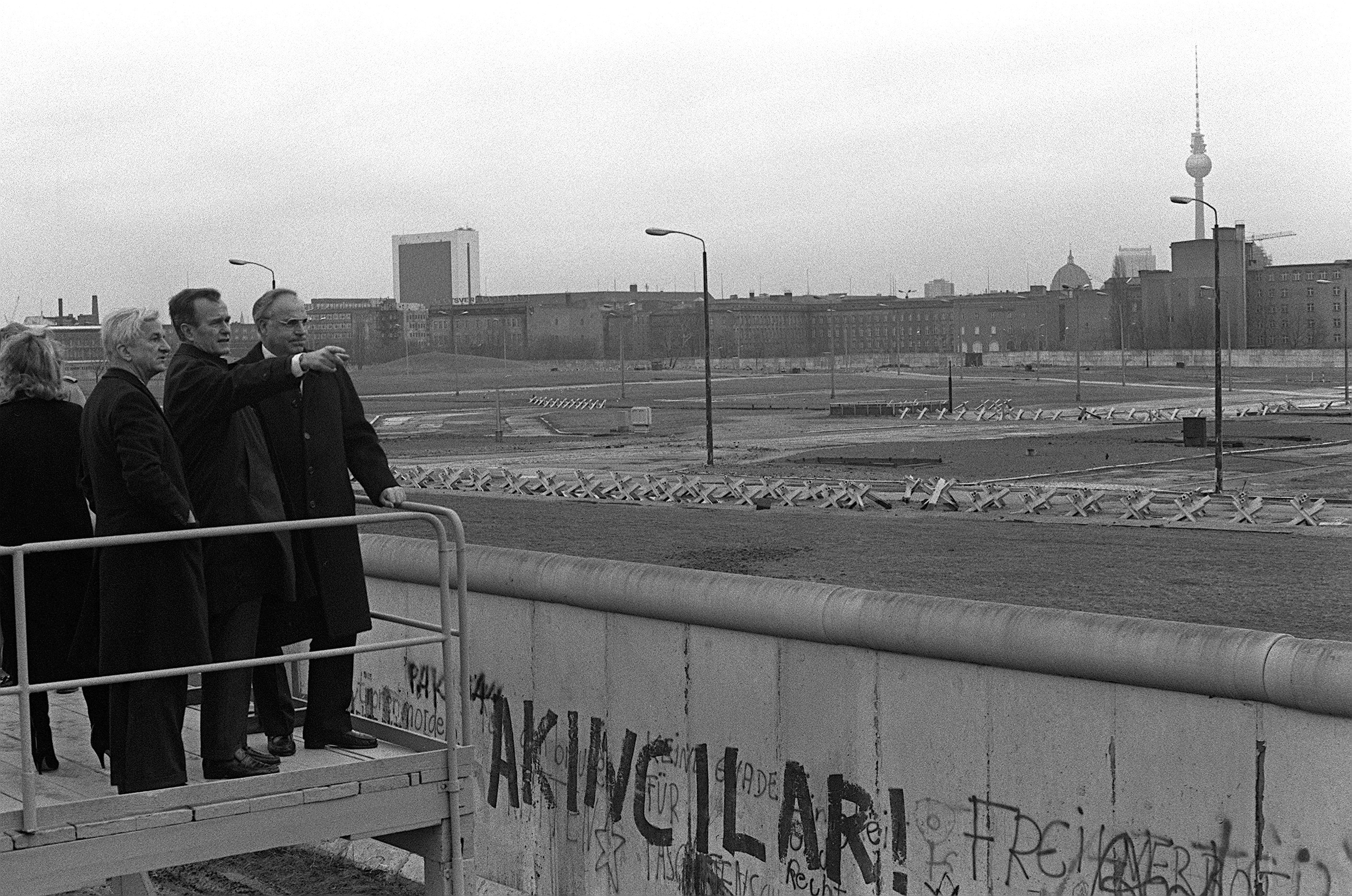 West German Chancellor Helmut Kohl and Berlin Mayor Richard von Weizsäcker show the Berlin Wall to U.S. Vice President George H.W. Bush on January 21, 1983. (National Archives)