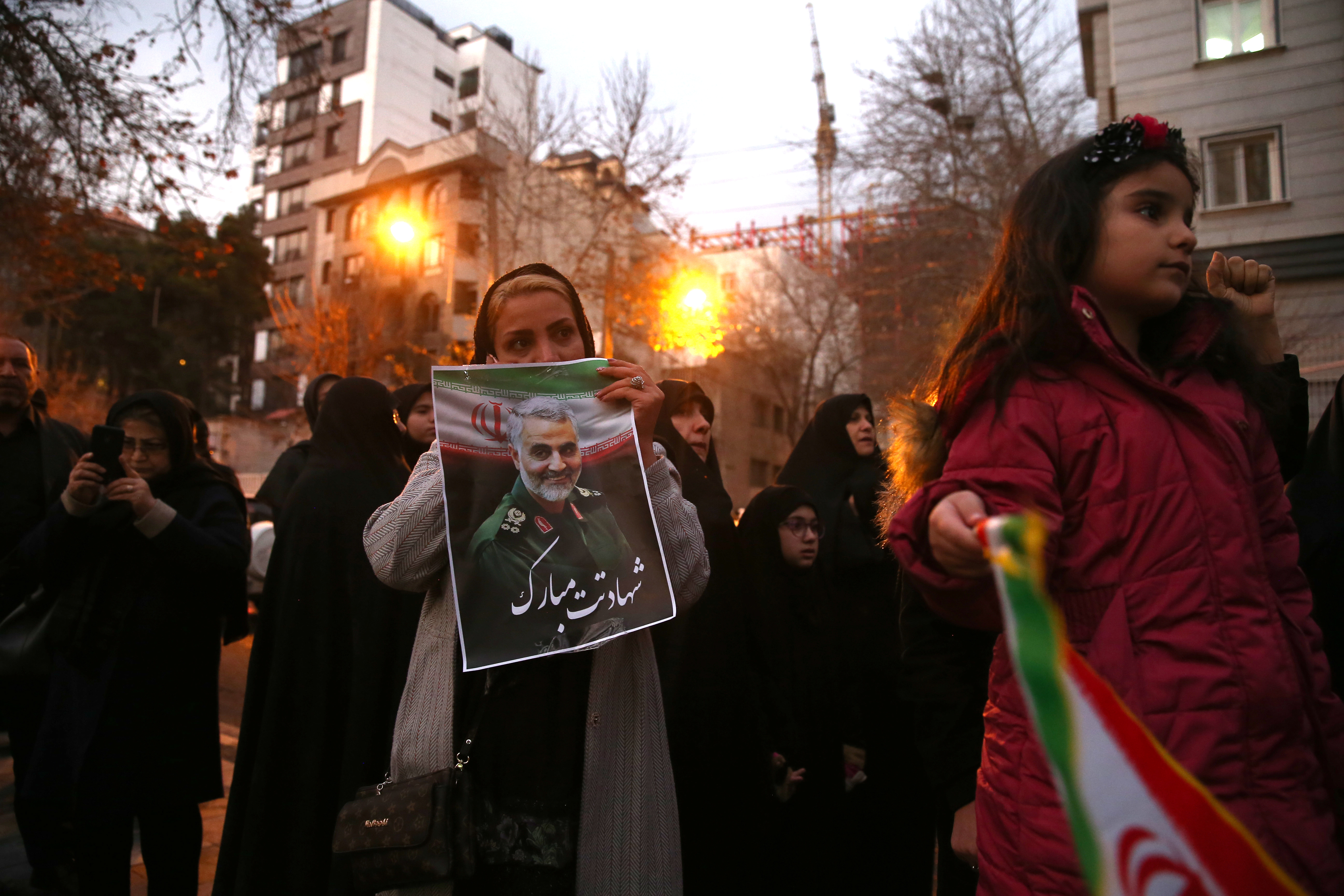 An Iranian demonstrator holds a picture of the late Iranian Major-General Qassem Soleimani, during a protest against the assassination of Soleimani, head of the elite Quds Force, and Iraqi militia commander Abu Mahdi al-Muhandis, who were killed in an air strike at Baghdad airport, in front of United Nation office in Tehran, Iran January 3, 2020. Nazanin Tabatabaee/WANA (West Asia News Agency) via REUTERS ATTENTION EDITORS - THIS IMAGE HAS BEEN SUPPLIED BY A THIRD PARTY.