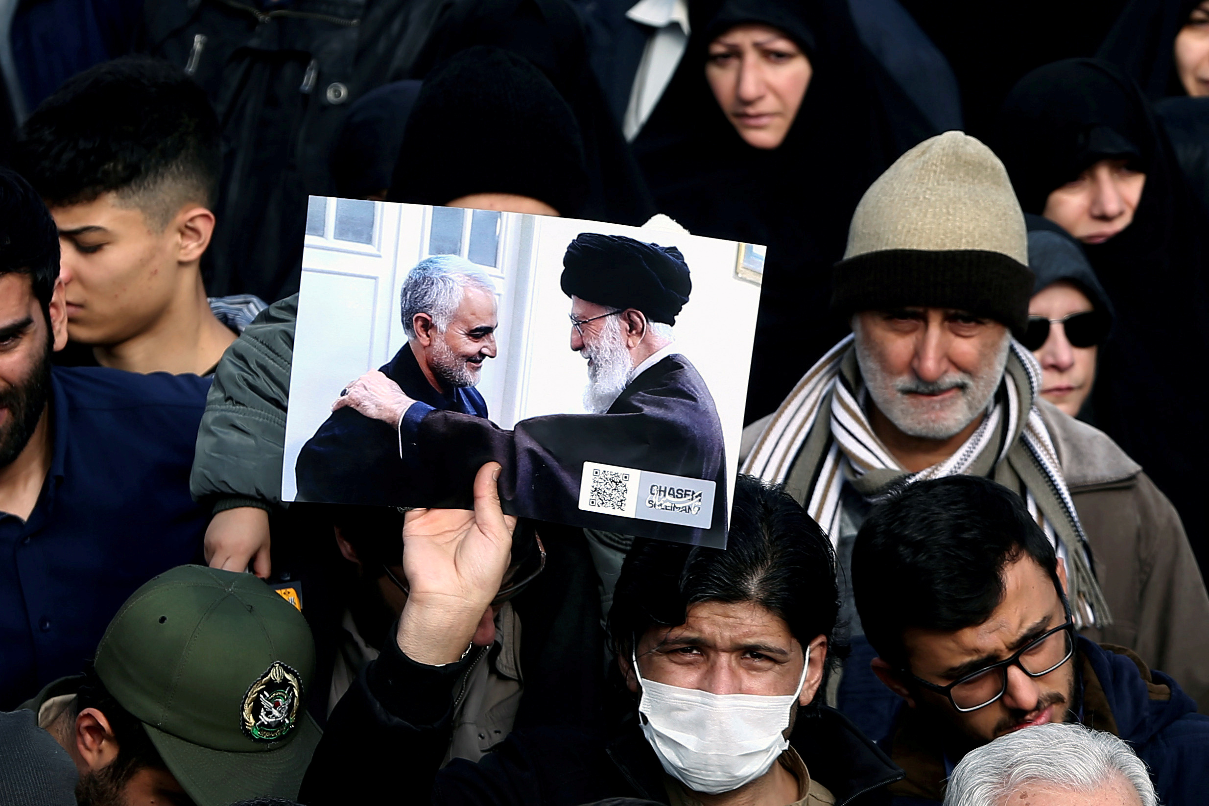 A demonstrator holds a picture of Supreme Leader Ayatollah Ali Khamenei with Iranian Major-General Qassem Soleimani, during protest against the assassination of Soleimani, head of the elite Quds Force, and Iraqi militia commander Abu Mahdi al-Muhandis who were killed in an air strike in Baghdad airport, in Tehran, Iran January 3, 2020. WANA (West Asia News Agency)/Nazanin Tabatabaee via REUTERS ATTENTION EDITORS - THIS IMAGE HAS BEEN SUPPLIED BY A THIRD PARTY.