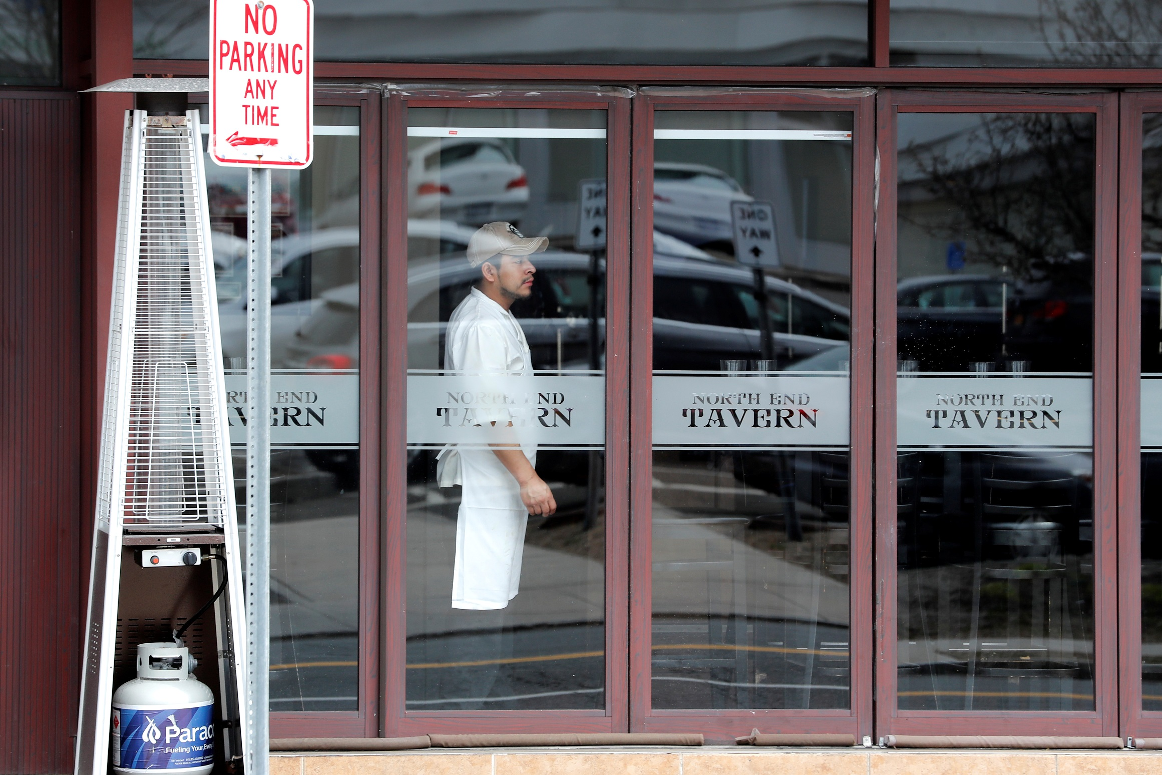 A worker looks out from a near empty restaurant on North Avenue during the coronavirus outbreak in New Rochelle, New York, U.S., March 11, 2020. REUTERS/Mike Segar