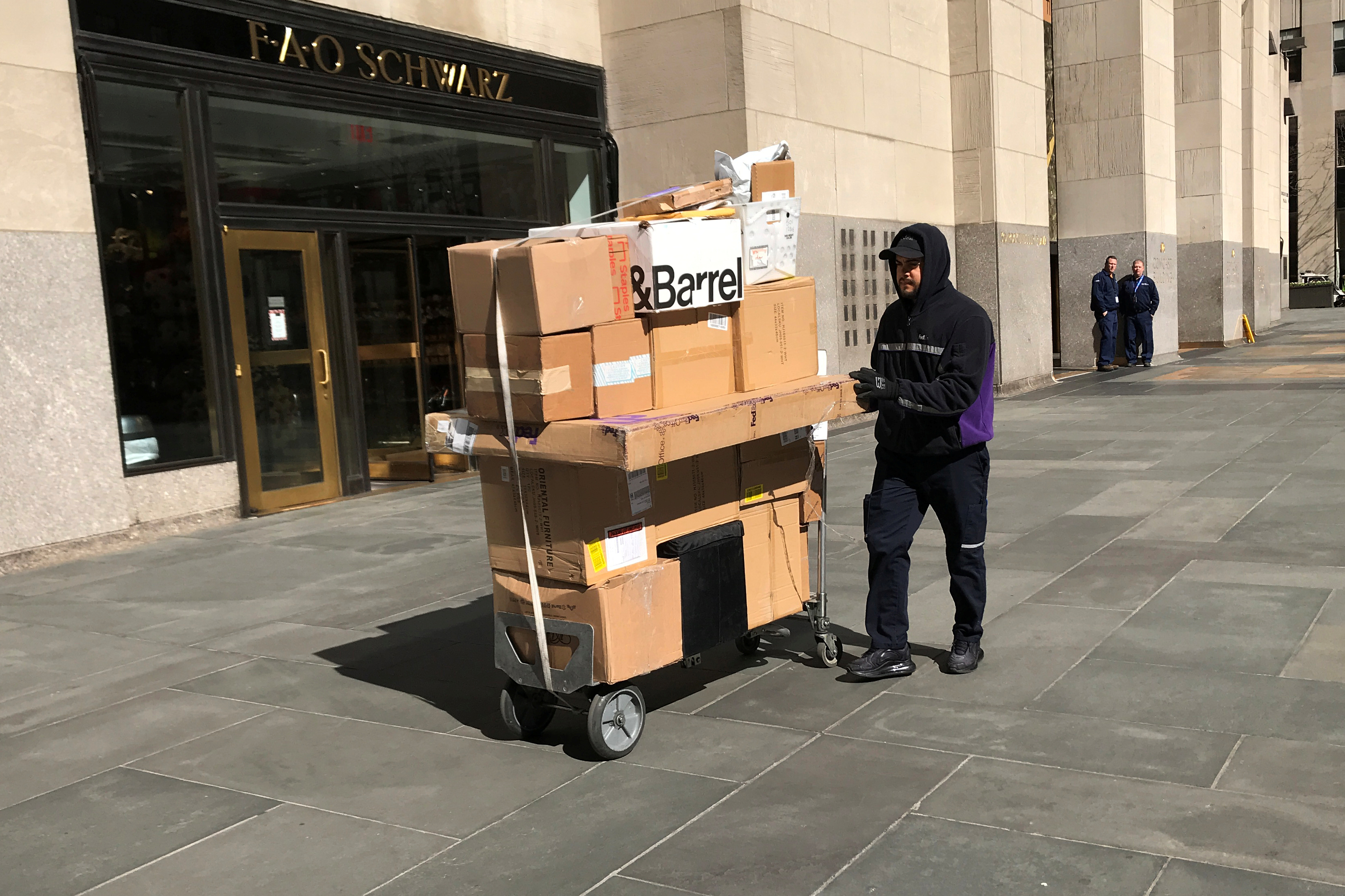 A worker delivers packages following the outbreak of coronavirus disease (COVID-19), in the Manhattan borough of New York City, New York, U.S., March 16, 2020. REUTERS/Carlo Allegri