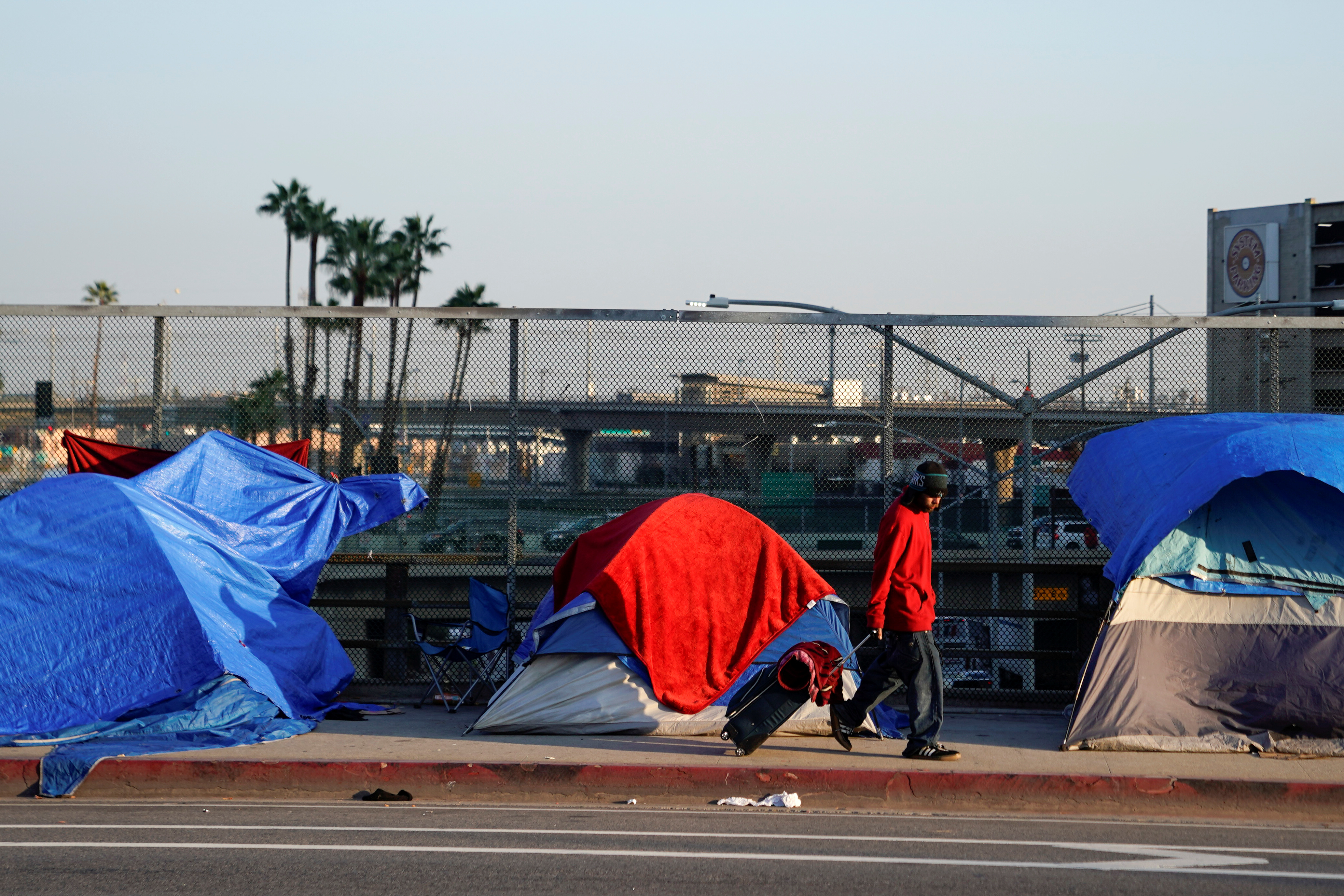 Tents and tarps are shown on the sidewalk of a freeway overpass home to hundreds of homeless living on the streets of Los Angeles, California, U.S., January 22, 2020.     REUTERS/Mike Blake