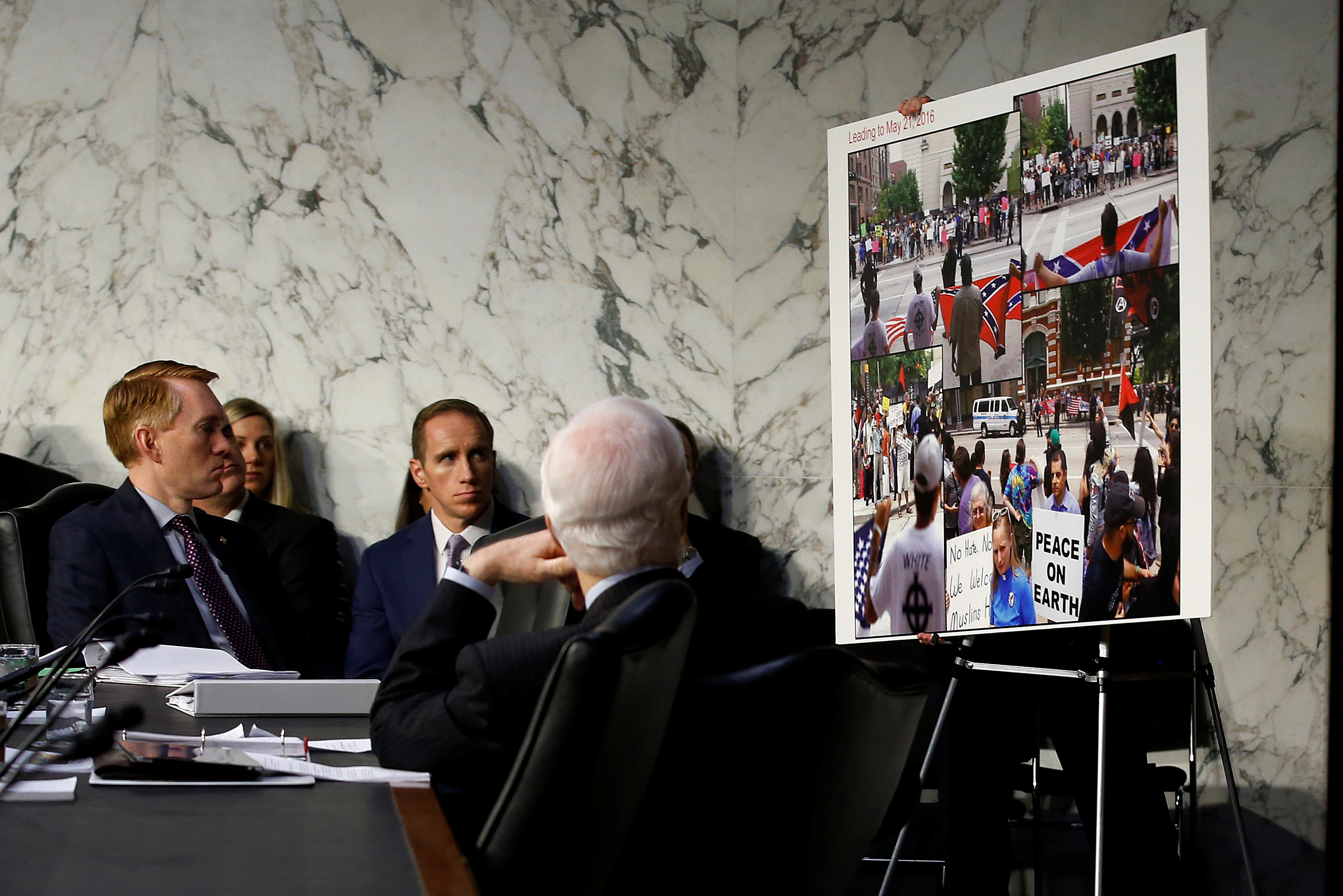 Senators look at a placard presented as evidence of Russian social media manipulation, during a Senate Intelligence Committee hearing to answer questions related to Russian use of social media to influence U.S. elections, on Capitol Hill in Washington, U.S., November 1, 2017.   REUTERS/Joshua Roberts
