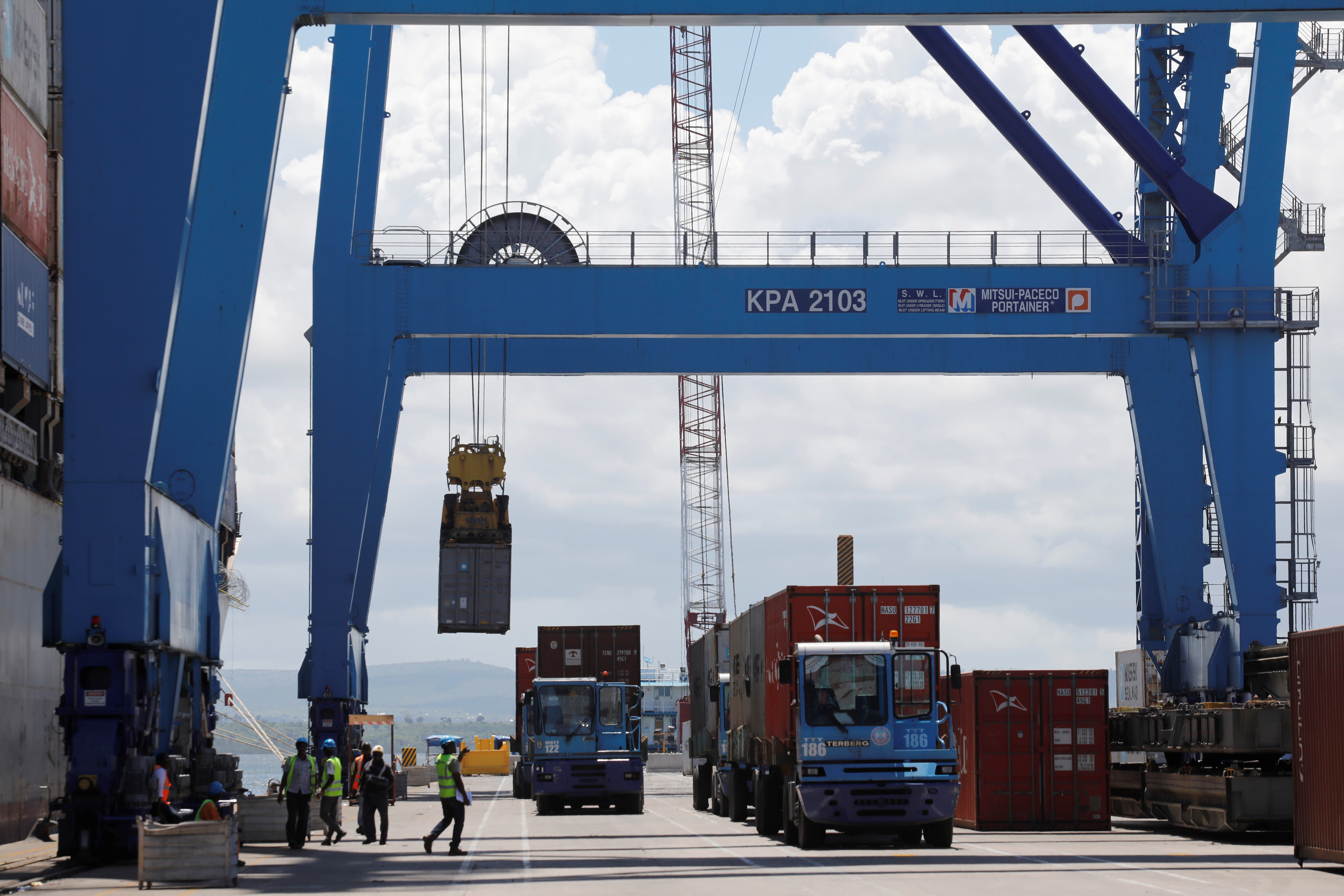 A crane loads shipping containers on a ship in the port of Mombasa, Kenya, October 23, 2019. Picture taken October 23, 2019. REUTERS/Baz Ratner