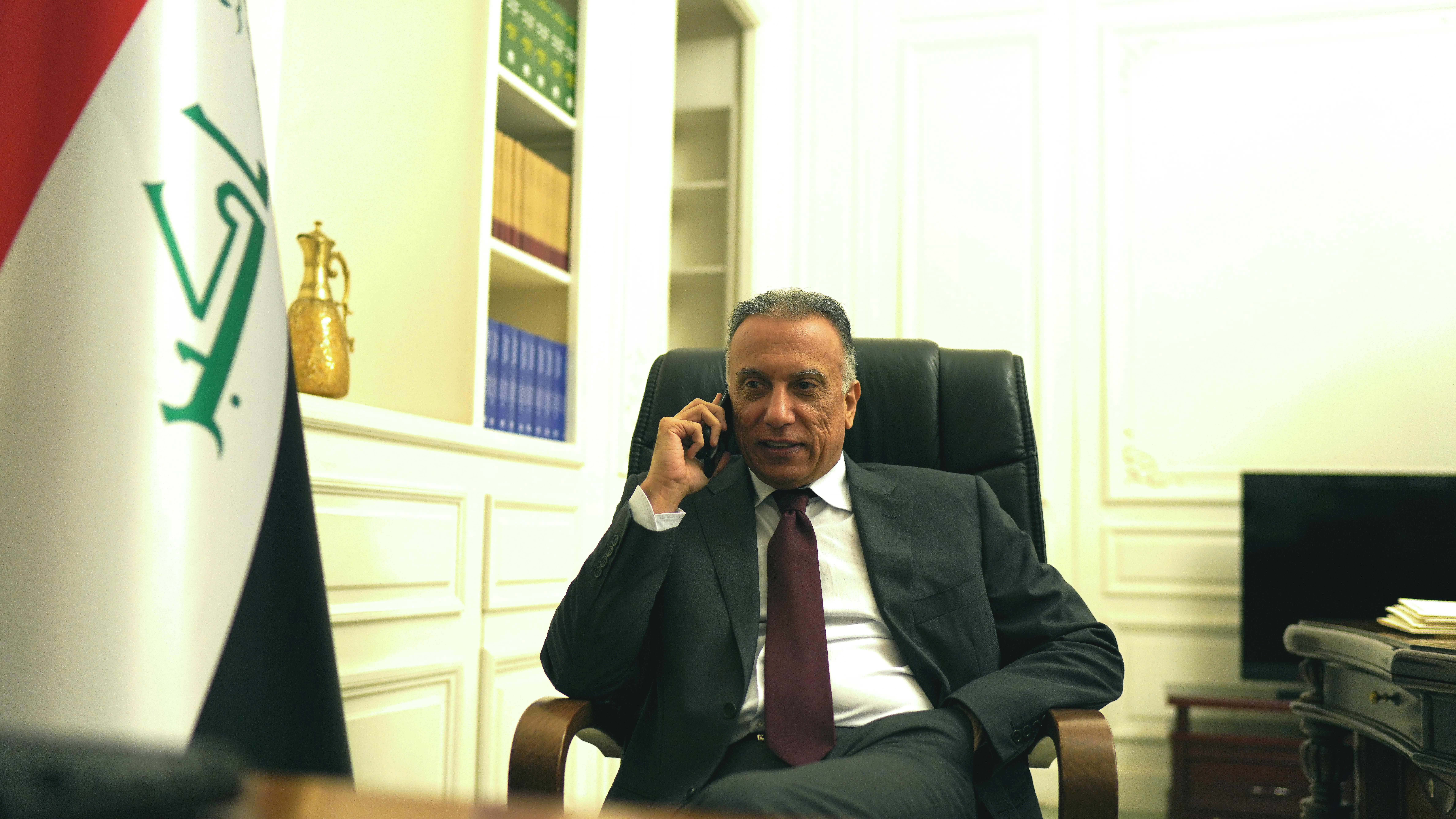 Iraqi Prime Minister Mustafa al-Kadhimi uses his mobile phone at his office in Baghdad, Iraq May 9, 2020. Picture taken May 9, 2020. Iraqi Prime Minister Media Office/Handout via REUTERS ATTENTION EDITORS - THIS IMAGE WAS PROVIDED BY A THIRD PARTY.