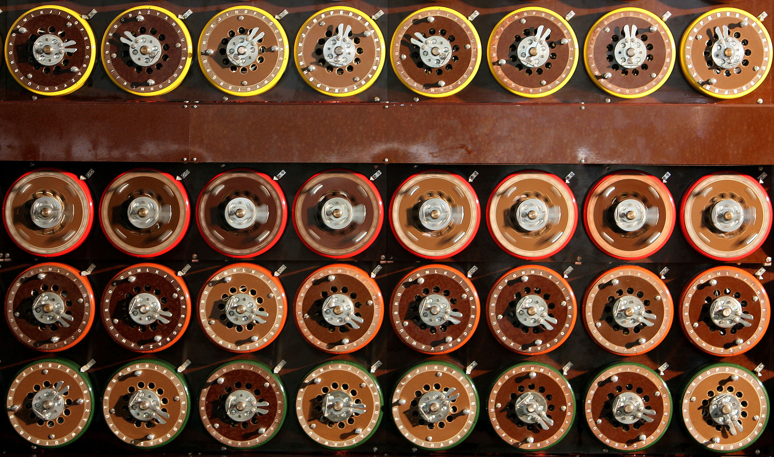 A British Turing Bombe machine is seen functioning in Bletchley Park Museum in Bletchley, central England, September 6, 2006. For the first time in sixty years Bletchley Park re-created the way the 'unbreakable' Enigma code was broken using functioning World War Two equipment. The Bombe was the brainchild of mathematical geniuses Alan Turing and Gordon Welchman, and enabled Bletchley Park's Cryptographers to decode over 3000 enemy messages a day breaking the codes created by German military Enigma machine during World War Two.   REUTERS/Alessia Pierdomenico (BRITAIN)