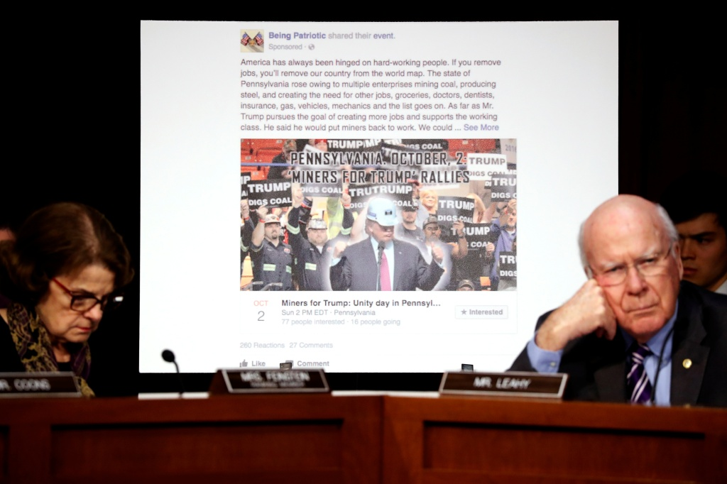 "U.S. Senator Dianne Feinstein (D-CA) (L) and Senator Pat Leahy (D-VT) show a fake social media post for a non-existent ""Miners for Trump"" rally as representatives of Twitter, Facebook and Google testify before a Senate Judiciary Crime and Terrorism Subcommittee hearing on how Russia allegedly used their services to try to sway the 2016 U.S. elections, on Capitol Hill in Washington, U.S. October 31, 2017. REUTERS/Jonathan Ernst"