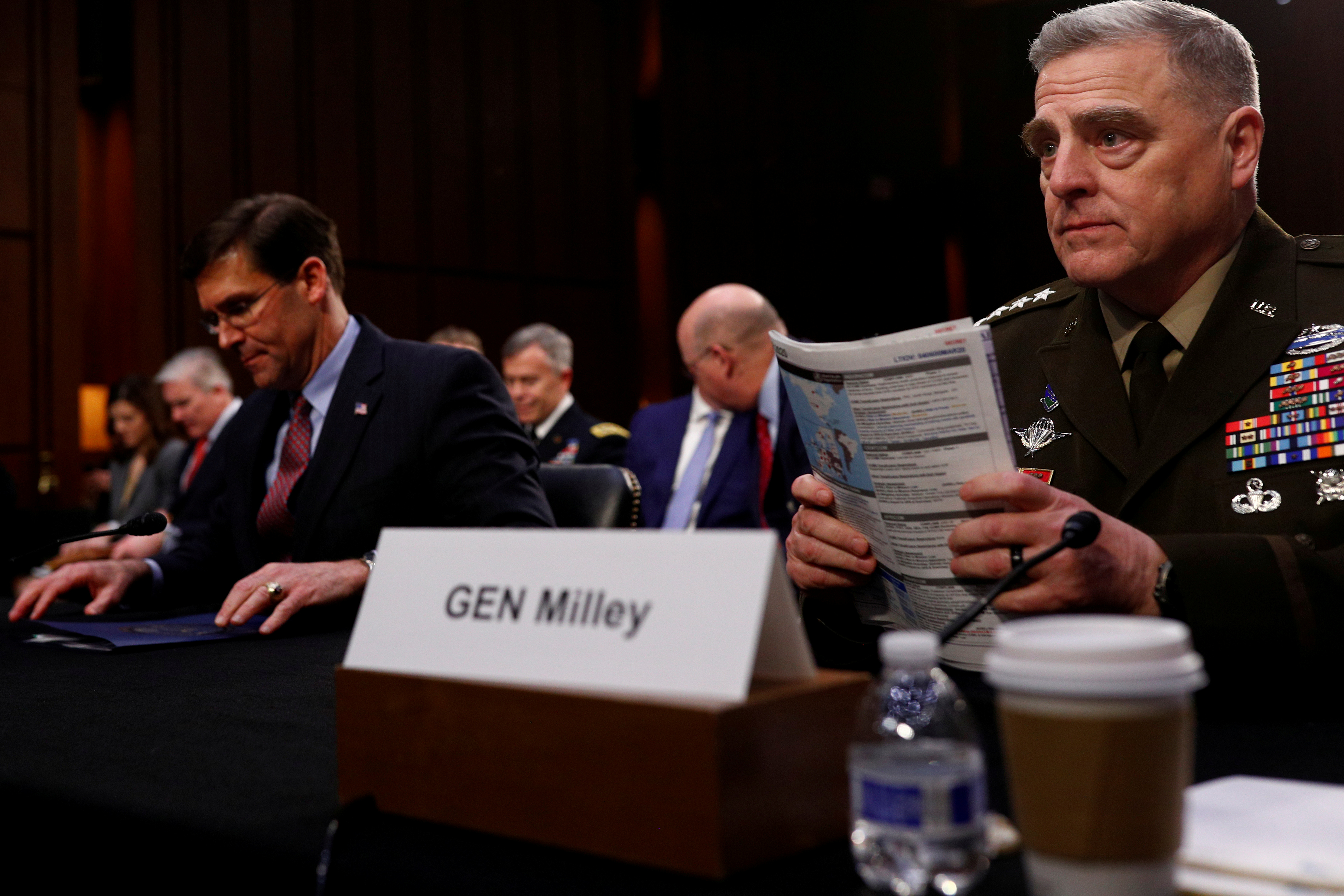 """FILE PHOTO: U.S. Chairman of the Joint Chiefs of Staff Gen. Mark A. Milley testifies beside U.S. Defense Secretary Mark Esper before a Senate Armed Services Committee hearing on """"Department of Defense Budget Posture"""" on Capitol Hill in Washington, U.S., March 4, 2020.  REUTERS/Tom Brenner/File Photo"""