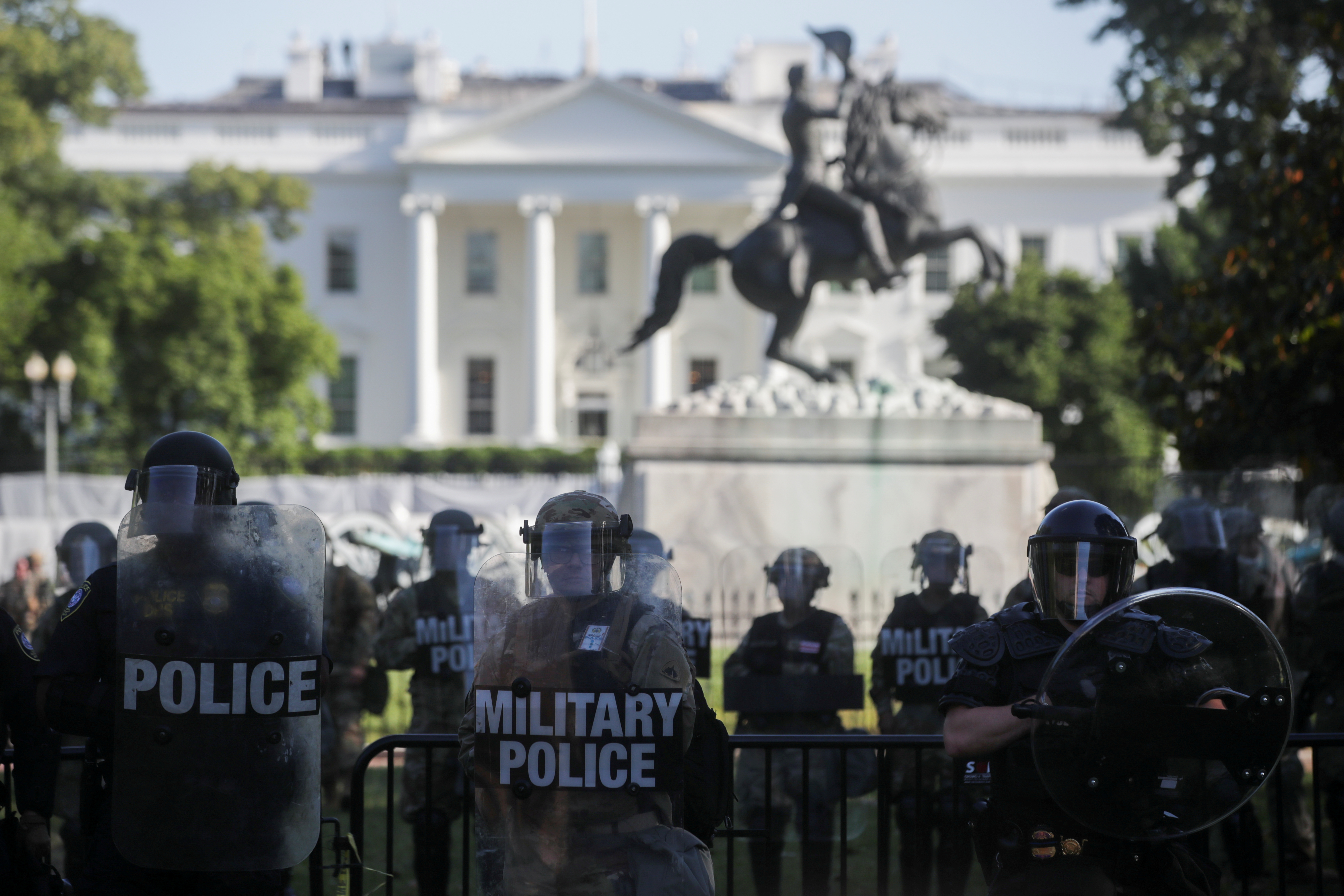 FILE PHOTO: DC National Guard military police officers look on as demonstrators rally near the White House against the death in Minneapolis police custody of George Floyd, in Washington, D.C., U.S., June 1, 2020. REUTERS/Jonathan Ernst/File Photo