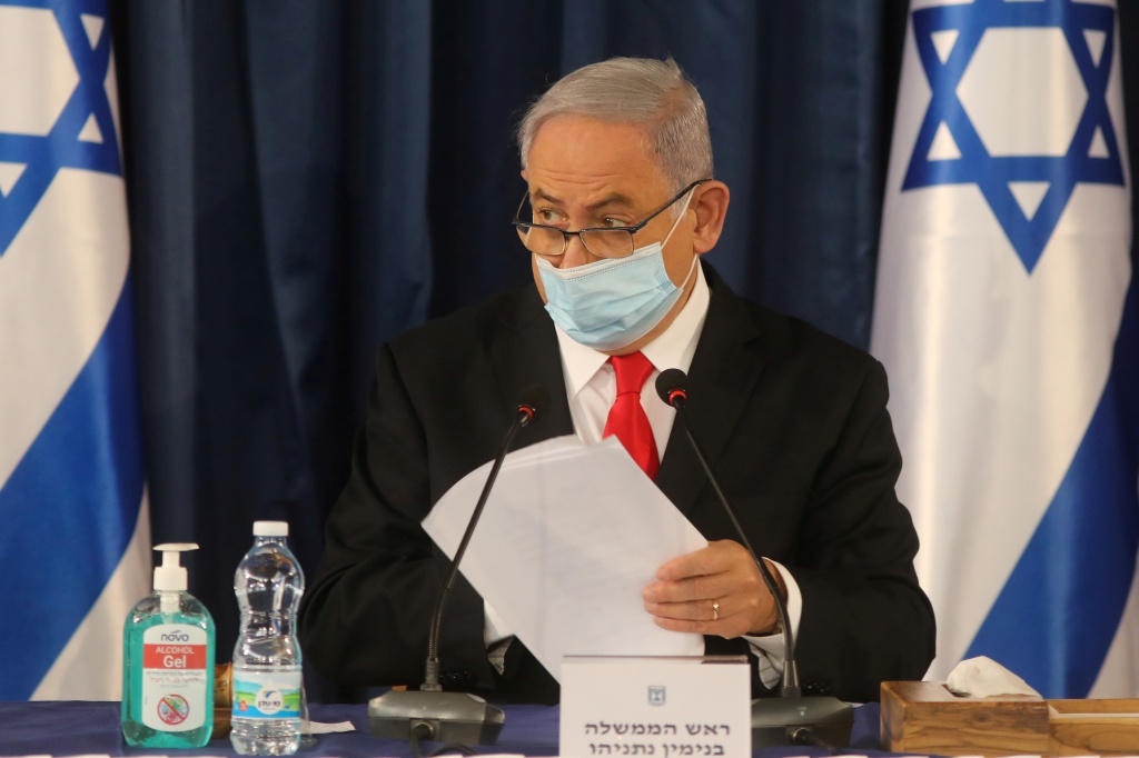 FILE PHOTO: Israeli Prime Minister Benjamin Netanyahu, wearing a protective mask due to the ongoing coronavirus disease (COVID-19) pandemic, chairs the weekly cabinet meeting in Jerusalem June 7, 2020. Menahem Kahana/Pool via REUTERS/File Photo