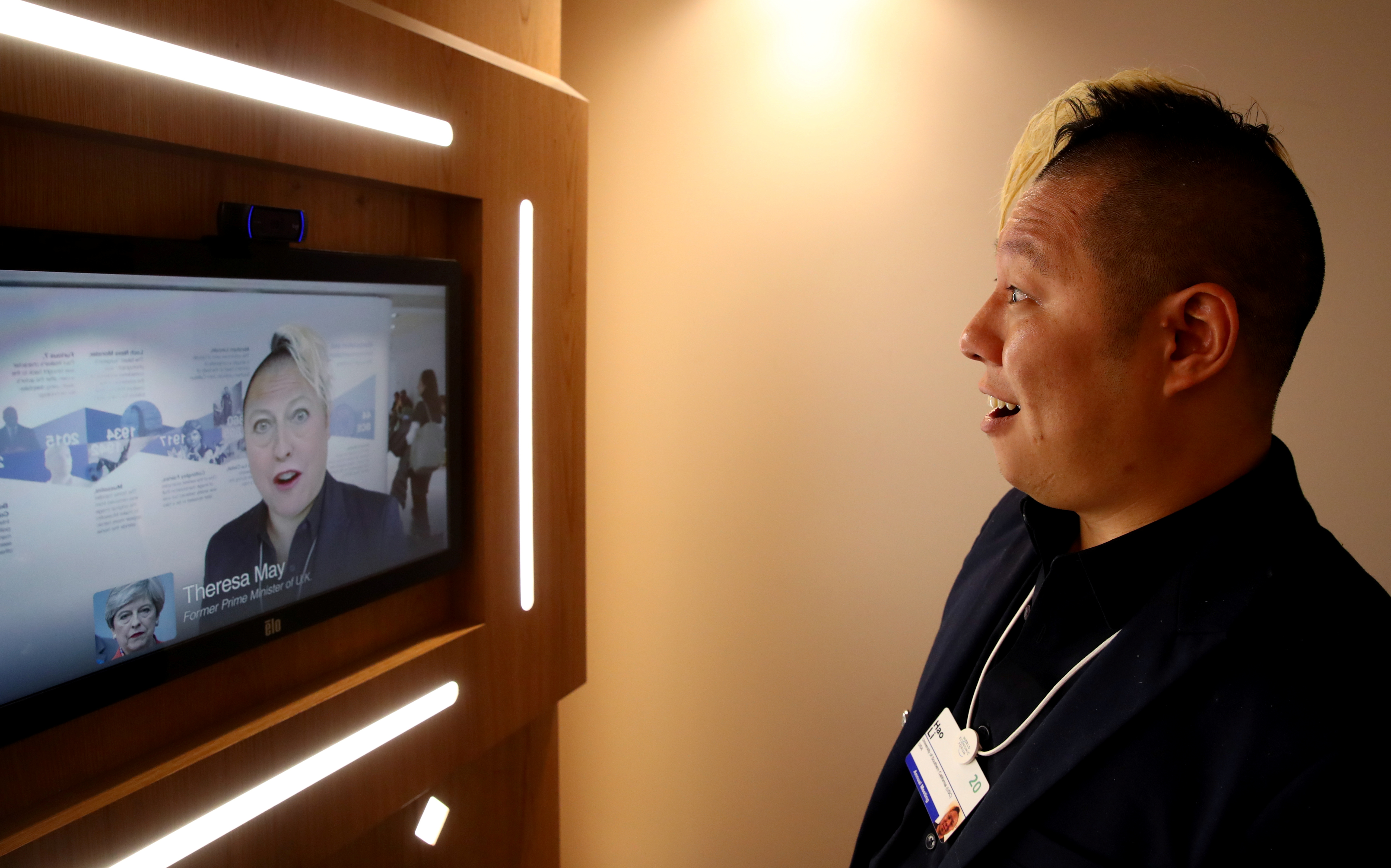 Associate professor of computer science at the University of Southern California Hao Li showcases a 'deepfake' video with Britain's former Prime Minister Theresa May during the 50th World Economic Forum (WEF) annual meeting in Davos, Switzerland, January 22, 2020. REUTERS/Denis Balibouse