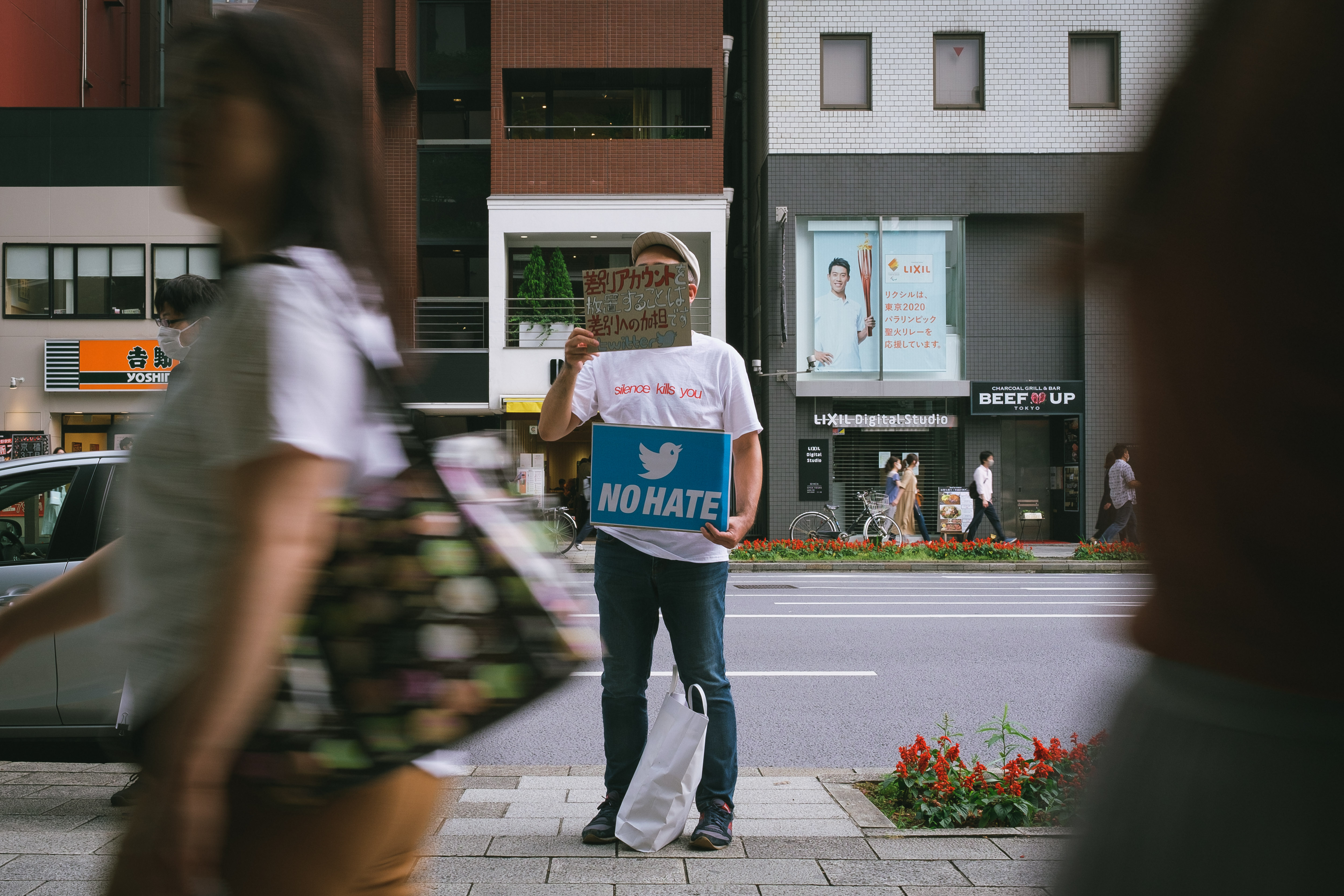 People gather in front of Twitter Japan headquarter to pressure the company to be more active against hate speech and discrimination on the platform on June 6, 2020 in Tokyo, Japan.