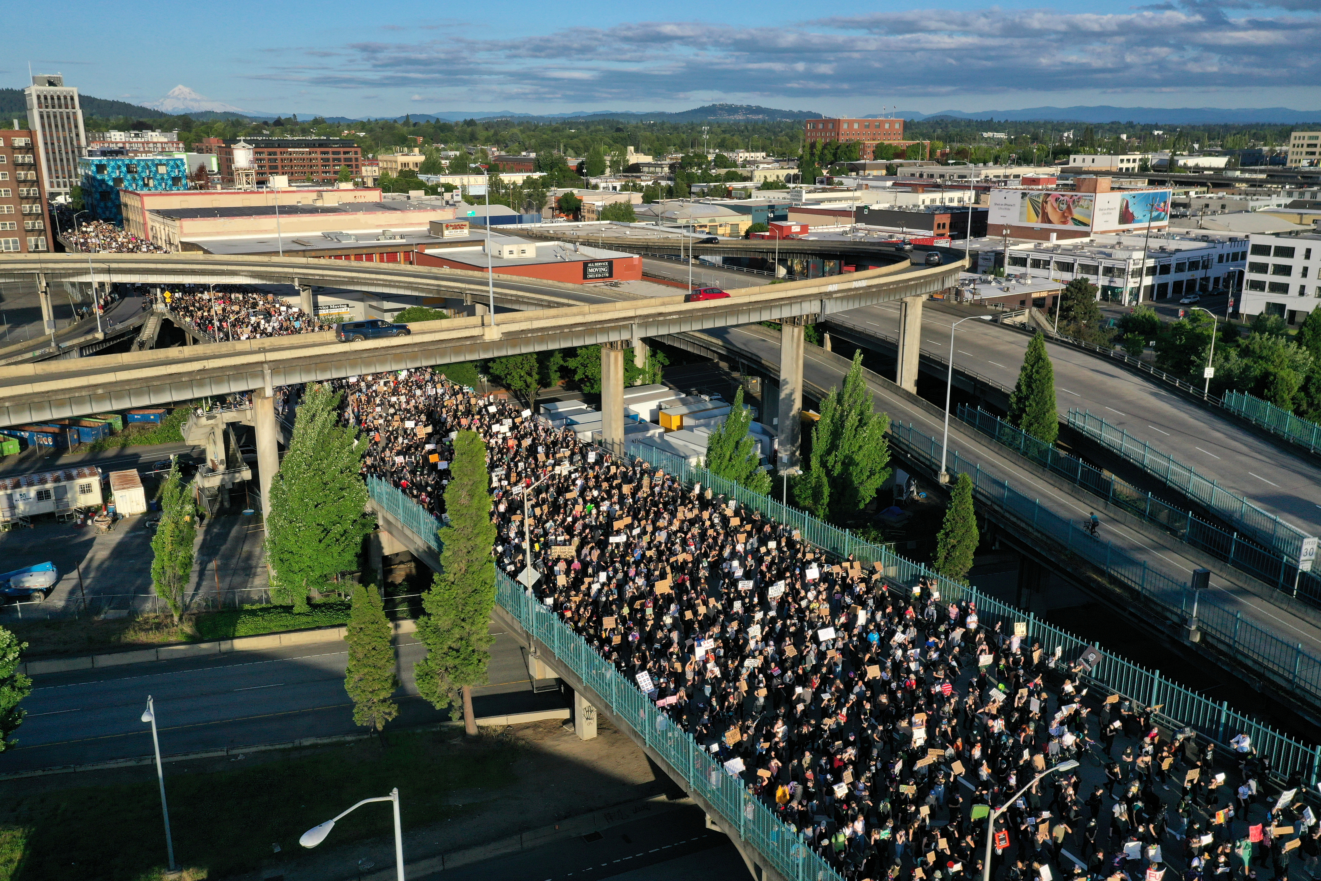 Protesters walk onto Morrison Bridge while rallying against the death in Minneapolis police custody of George Floyd, in Portland, Oregon, U.S. June 3, 2020. Picture taken with a drone. REUTERS/Terray Sylvester