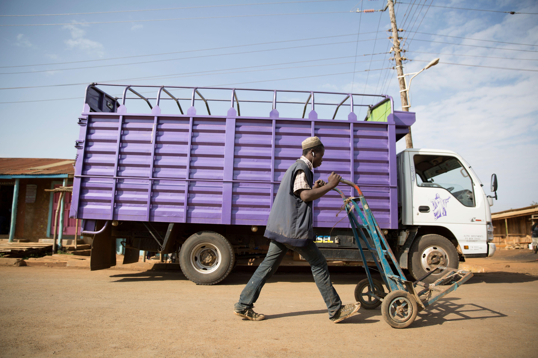 Eldoret,Uasin gishu/Kenya 25 January 2018: Unidentified man with a push cart walking next to a truck.